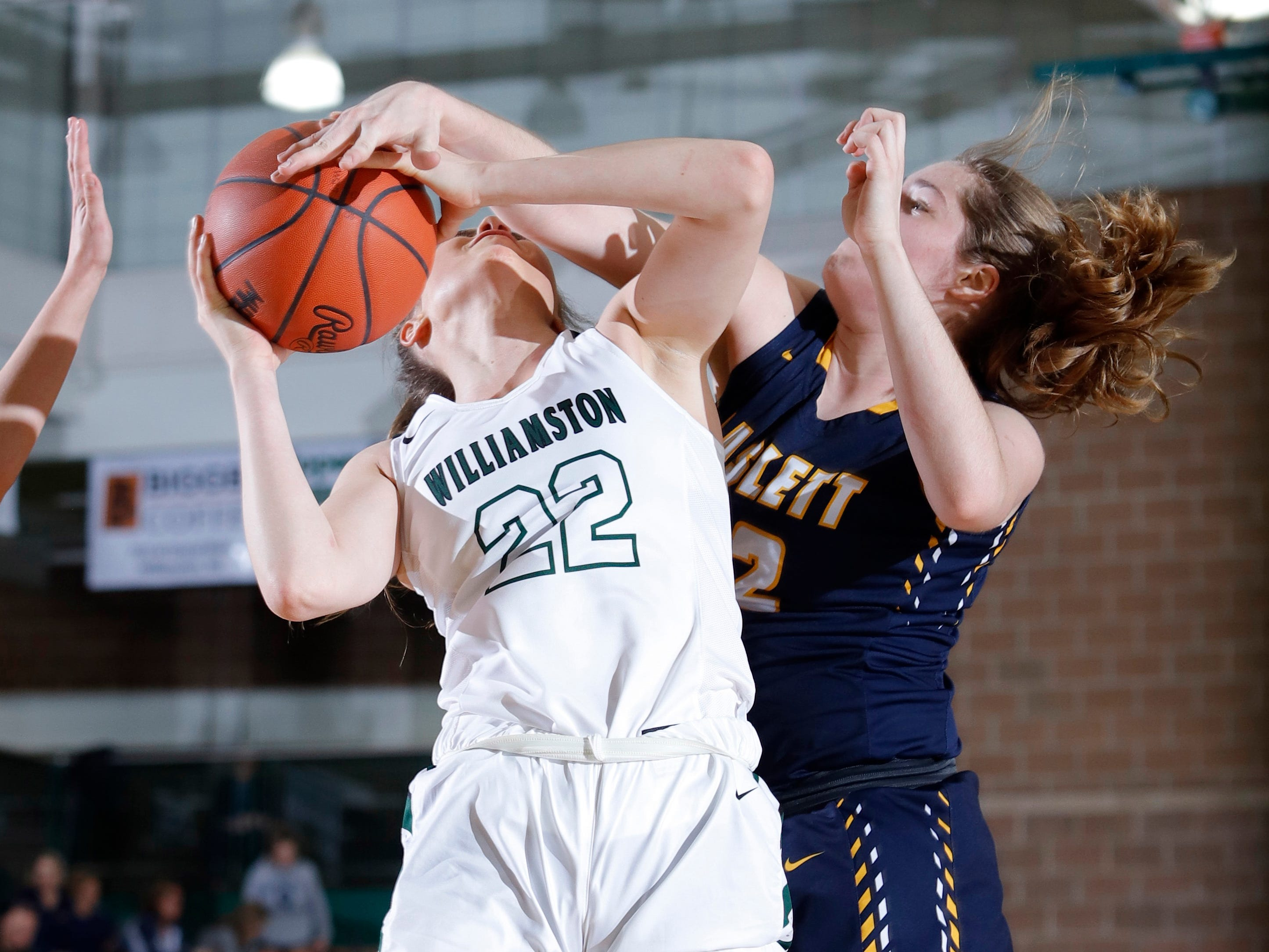 Williamston's Kenzie Lewis (22) shoots and draws a foul against Haslett's Olivia Green, Friday, Jan. 11, 2019, in Williamston, Mich.
