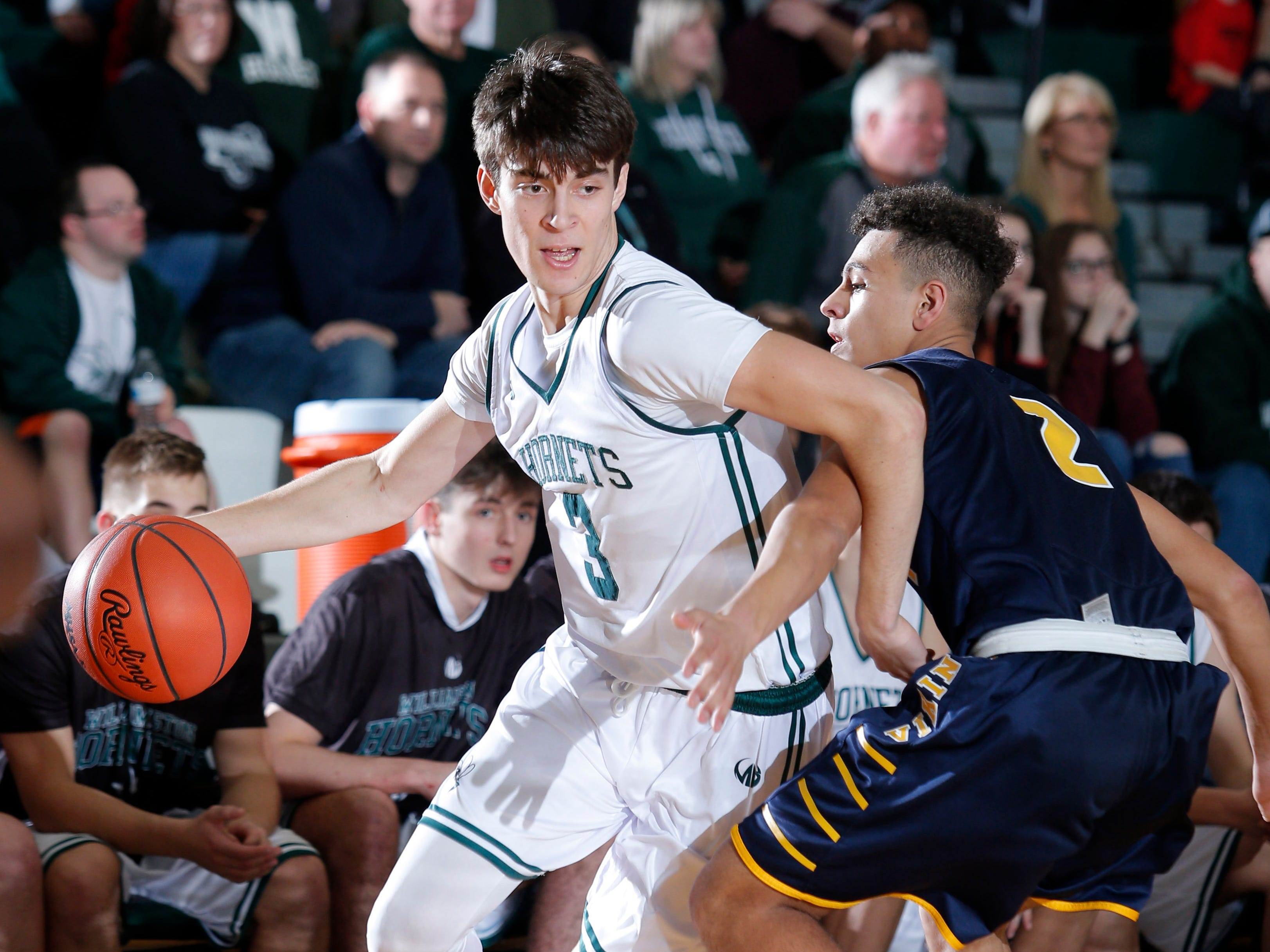 Williamston's Case Conley, left, drives against Haslett's Ty Andrades, Friday, Jan. 11, 2019, in Williamston, Mich.