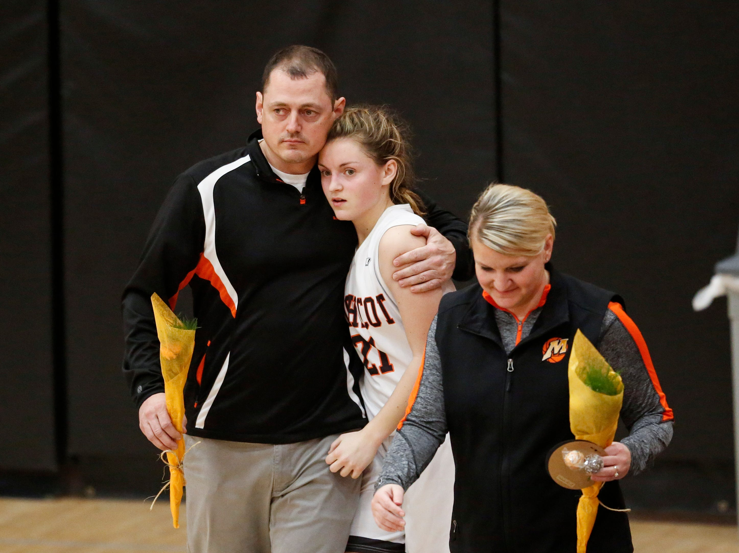 Mishicot's head coach Mike Garceau gives his daughter Abigail Garceau a hug during parents night at Mishicot High School Friday, January 11, 2019, in Mishicot, Wis. Joshua Clark/USA TODAY NETWORK-Wisconsin