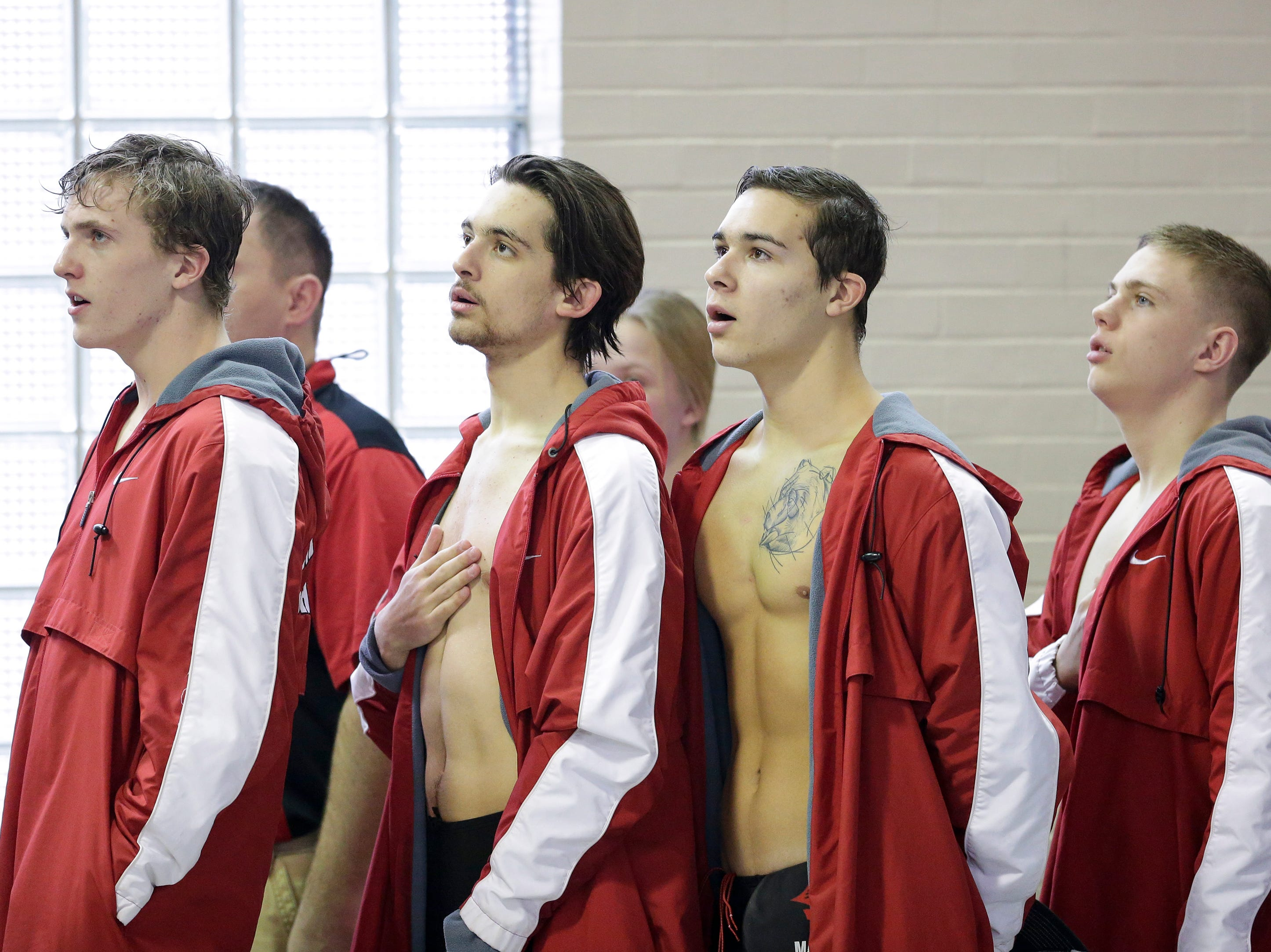 Manitowoc Lincoln's boys swim team sings the National anthem before the Lincoln Boys Swim Invitational at Manitowoc Lincoln High School Saturday, January 12, 2019, in Manitowoc, Wis. Joshua Clark/USA TODAY NETWORK-Wisconsin