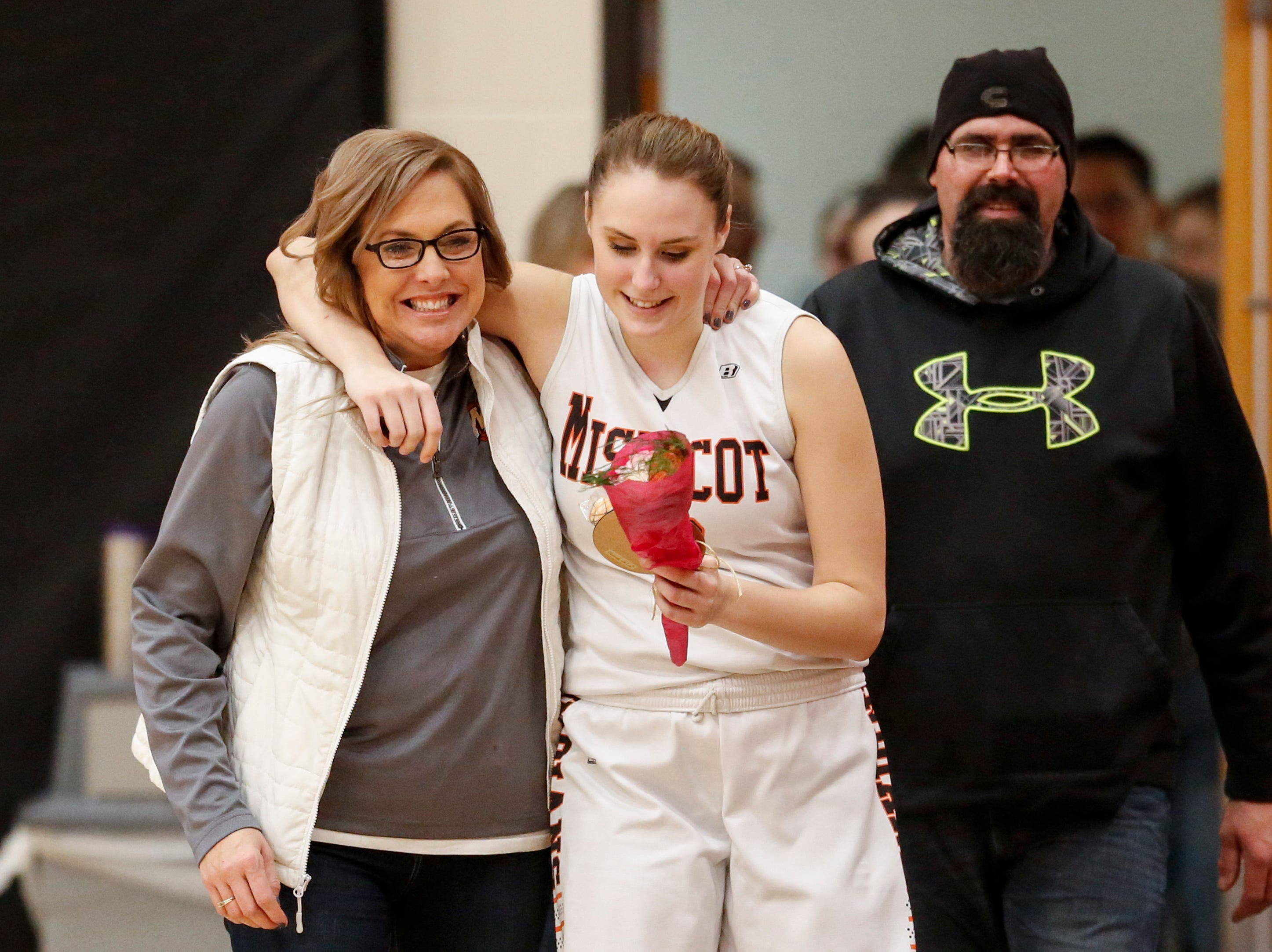 Mishicot's Dakota Krieser gives her mother a hug during parents night at Mishicot High School Friday, January 11, 2019, in Mishicot, Wis. Joshua Clark/USA TODAY NETWORK-Wisconsin