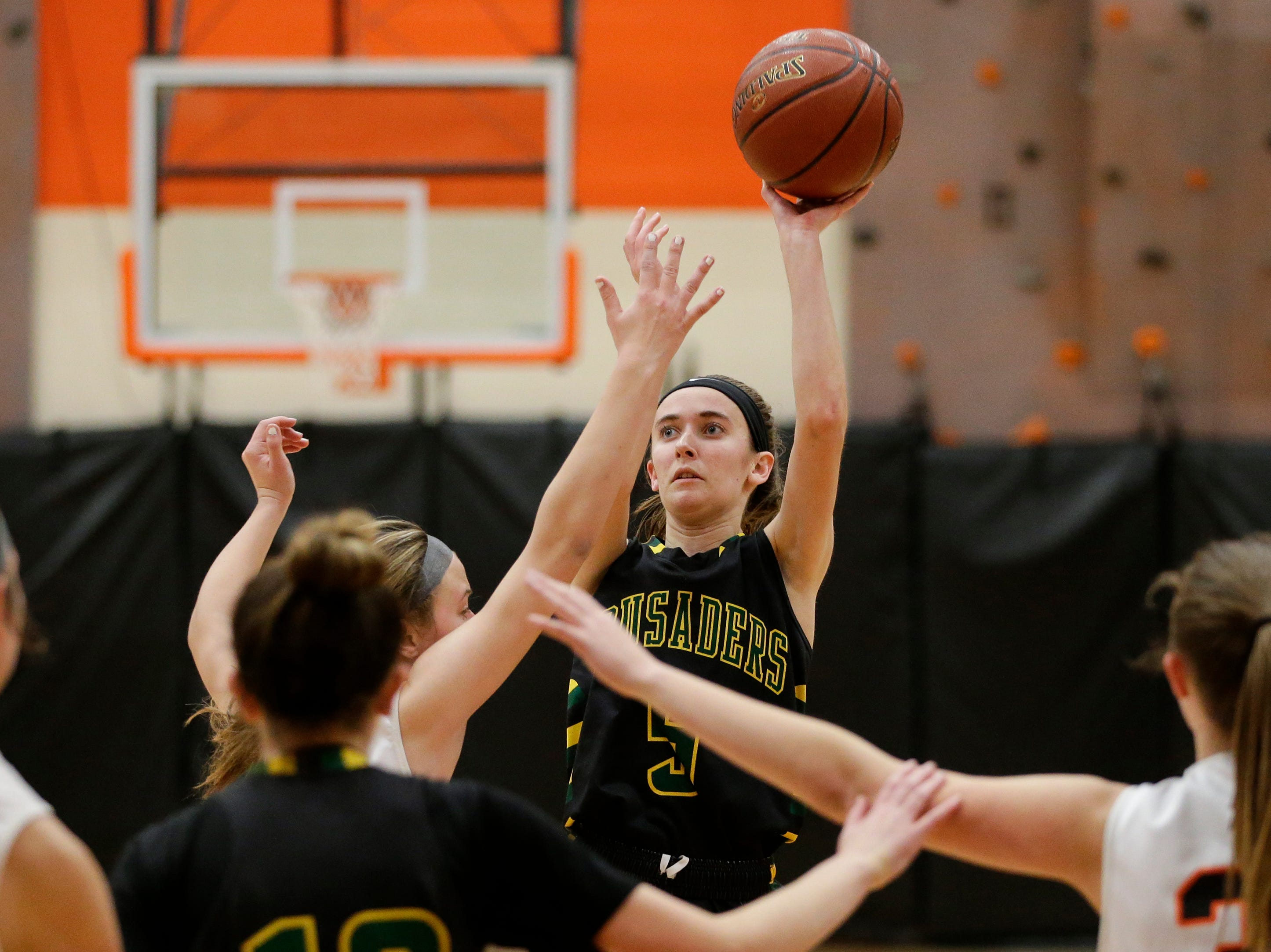Sheboygan Area Lutheran's Katelyn Witte (5) shoots against Mishicot during a Big East Conference matchup at Mishicot High School Friday, January 11, 2019, in Mishicot, Wis. Joshua Clark/USA TODAY NETWORK-Wisconsin