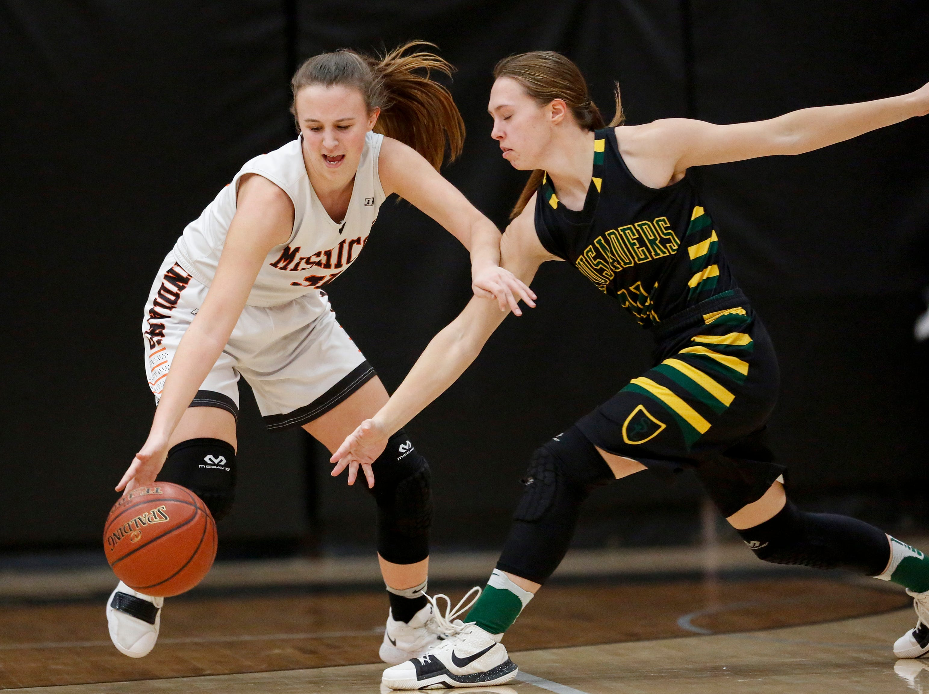 Mishicot's Kylie Schmidt (31) steals the ball from Sheboygan Area Lutheran's Makell Babak (14) during a Big East Conference matchup at Mishicot High School Friday, January 11, 2019, in Mishicot, Wis. Joshua Clark/USA TODAY NETWORK-Wisconsin