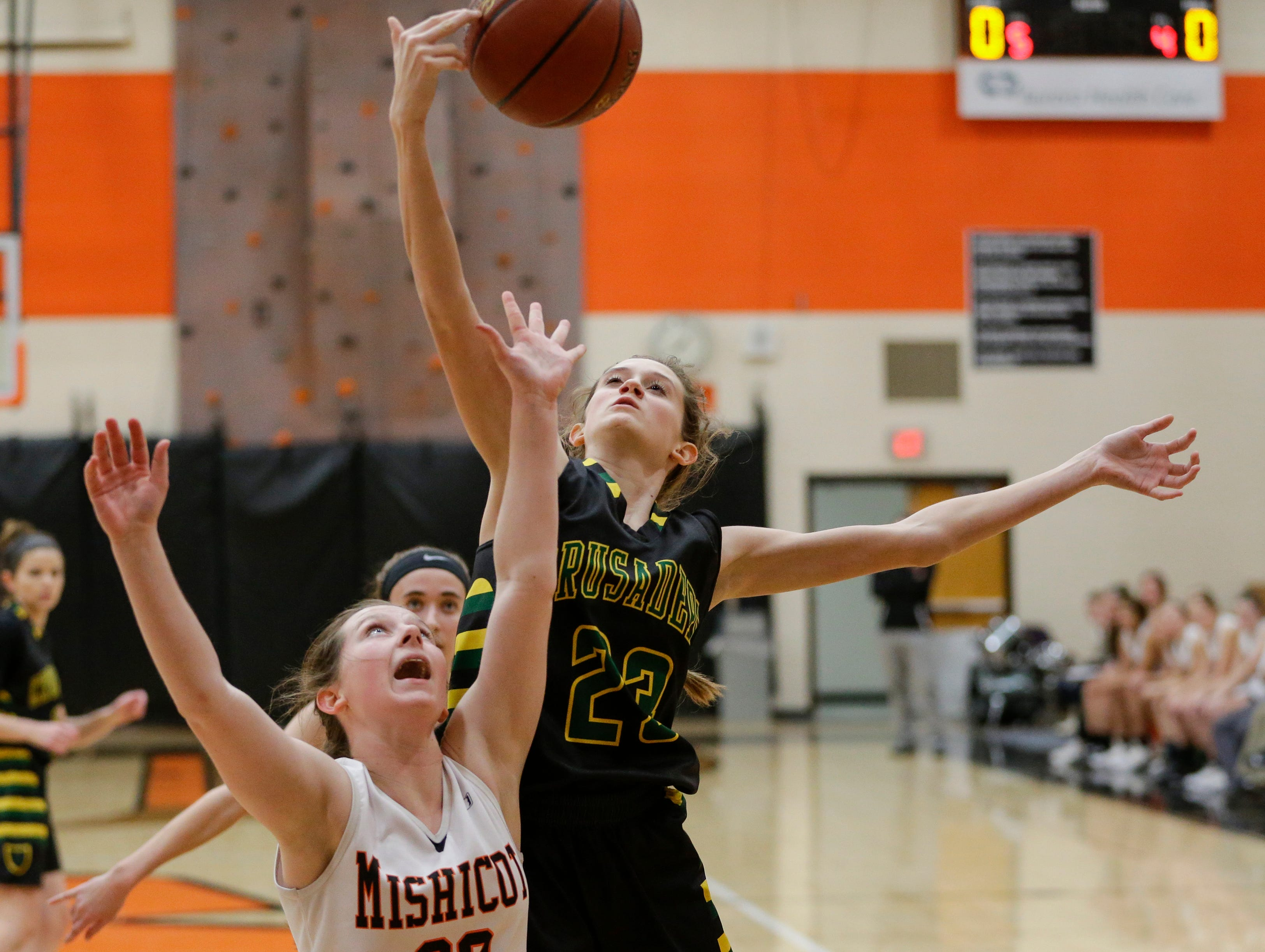 Sheboygan Area Lutheran's Carly Schreurs (23) rebounds against Mishicot during a Big East Conference matchup at Mishicot High School Friday, January 11, 2019, in Mishicot, Wis. Joshua Clark/USA TODAY NETWORK-Wisconsin
