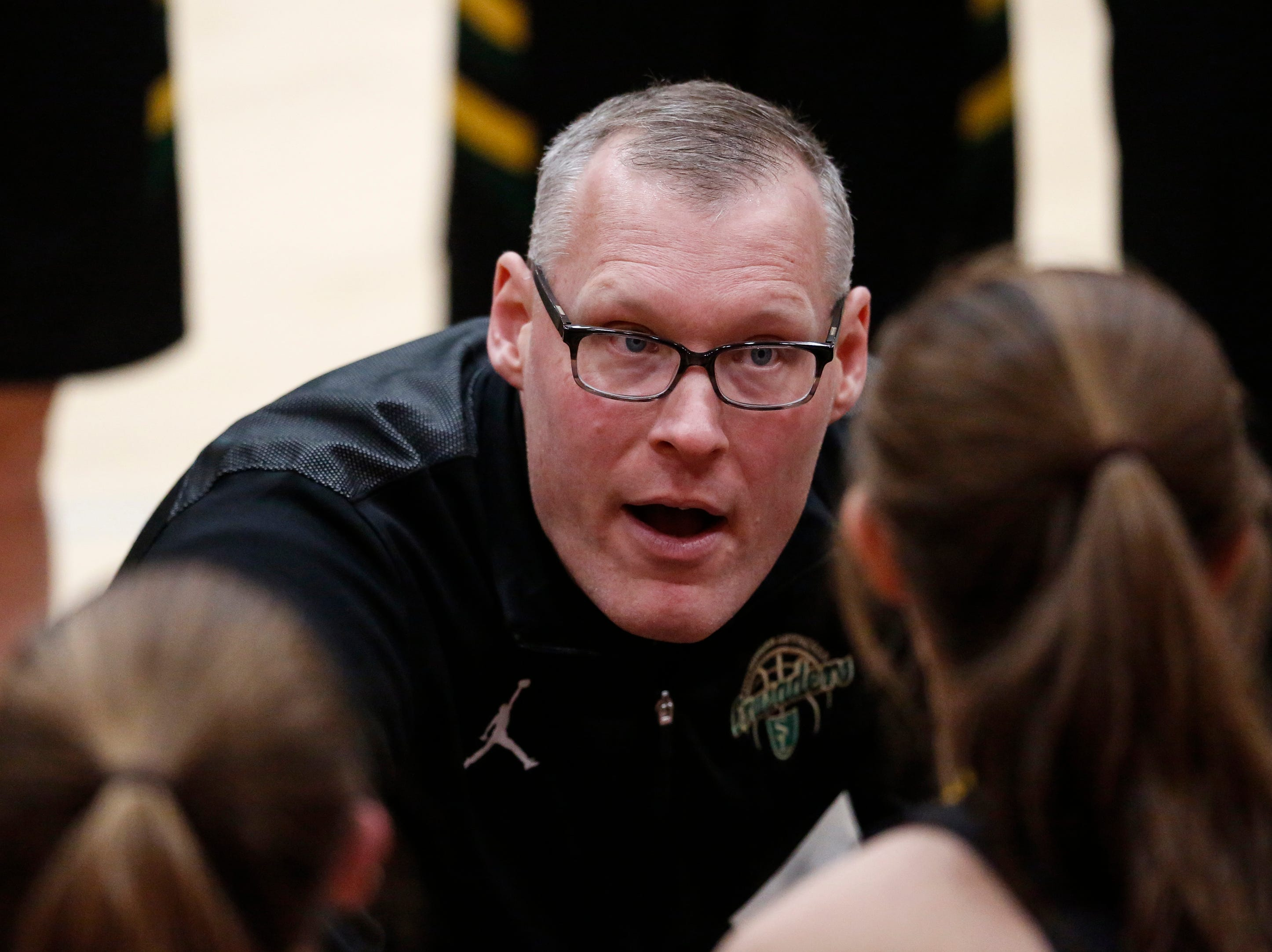 Sheboygan Area Lutheran's head coach Mike Scheele talks to his team during a Big East Conference matchup against Mishicot at Mishicot High School Friday, January 11, 2019, in Mishicot, Wis. Joshua Clark/USA TODAY NETWORK-Wisconsin