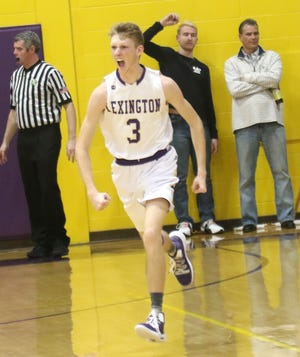 Lexington's Kyle Johnston celebrates making a three pointer while playing against Mansfield Senior on Friday.