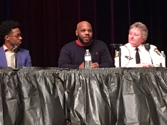 Carlos Christian, a reformed felon, talks about the need for law enforcement, kids, young and old, black and white, all people, to treat people the way they want to be treated, bringing harmony to earth. He spoke Saturday during the Community Conversation at Mansfield Senior High panel discussion. At left is Jaylon Scott. At right, Mansfield police Capt. Shari Robertson.