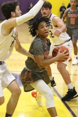 Mansfield Senior's De'Zion Taylor goes for the basket while playing at Lexington on Friday.