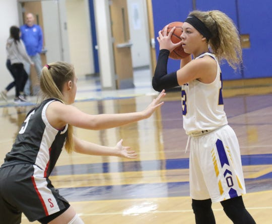 Ontario's Carleigh Pearson passes the ball while playing against Shelby earlier in the season.