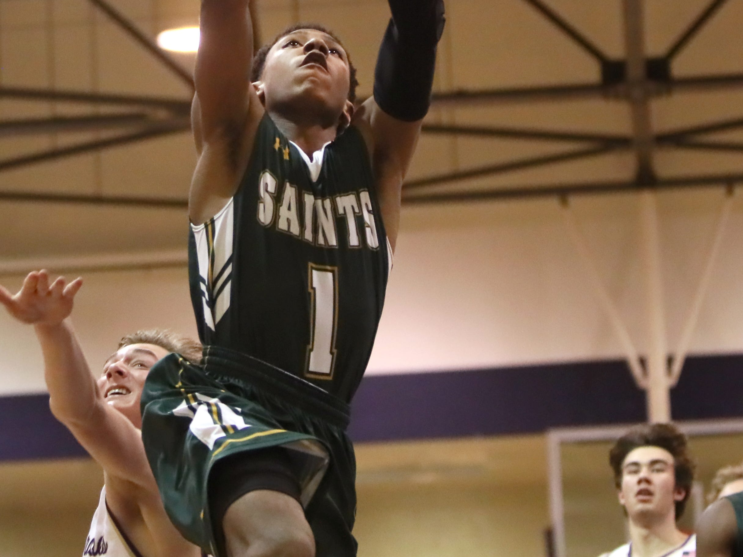 Briarcrest's Kennedy Chandler dunks the ball during their game at Christian Brothers High School on Friday, Jan. 11, 2019.
