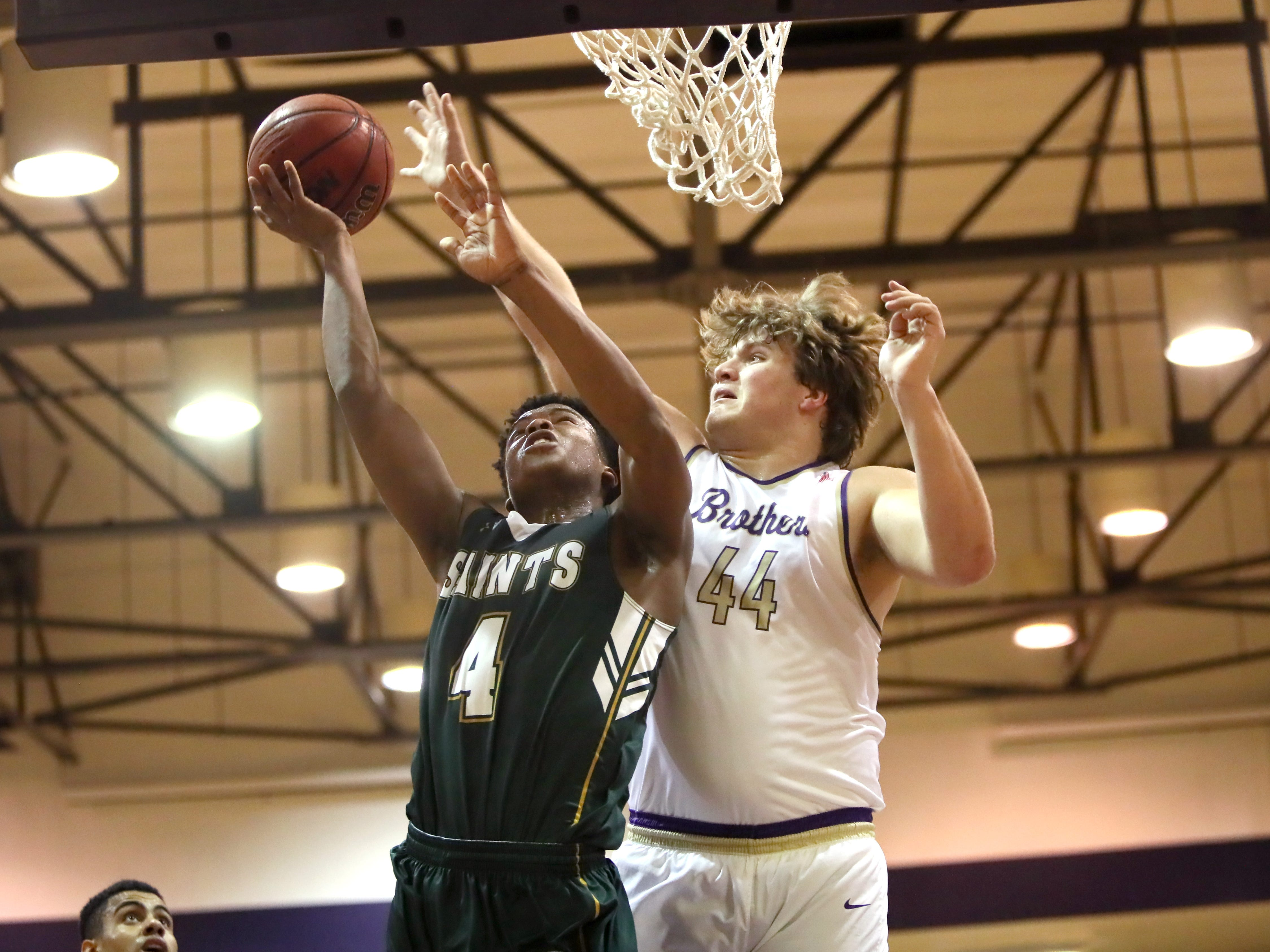 Briarcrest's shoots the ball over Christian Brothers' Bill Norton during their game at Christian Brothers High School on Friday, Jan. 11, 2019.