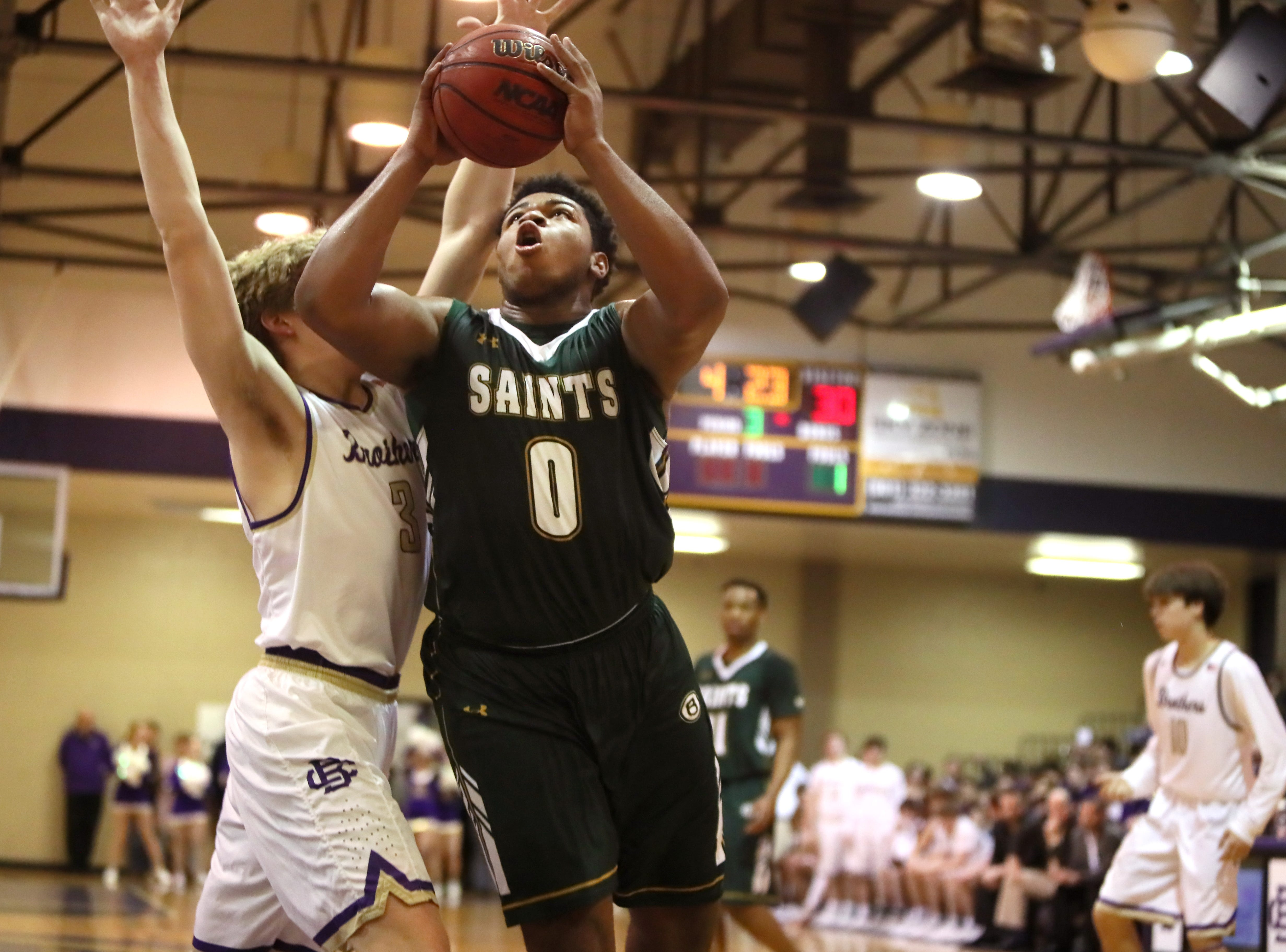 Briarcrest's Omari Thomas drives past Christian Brothers' Clint Channell during their game at Christian Brothers High School on Friday, Jan. 11, 2019.