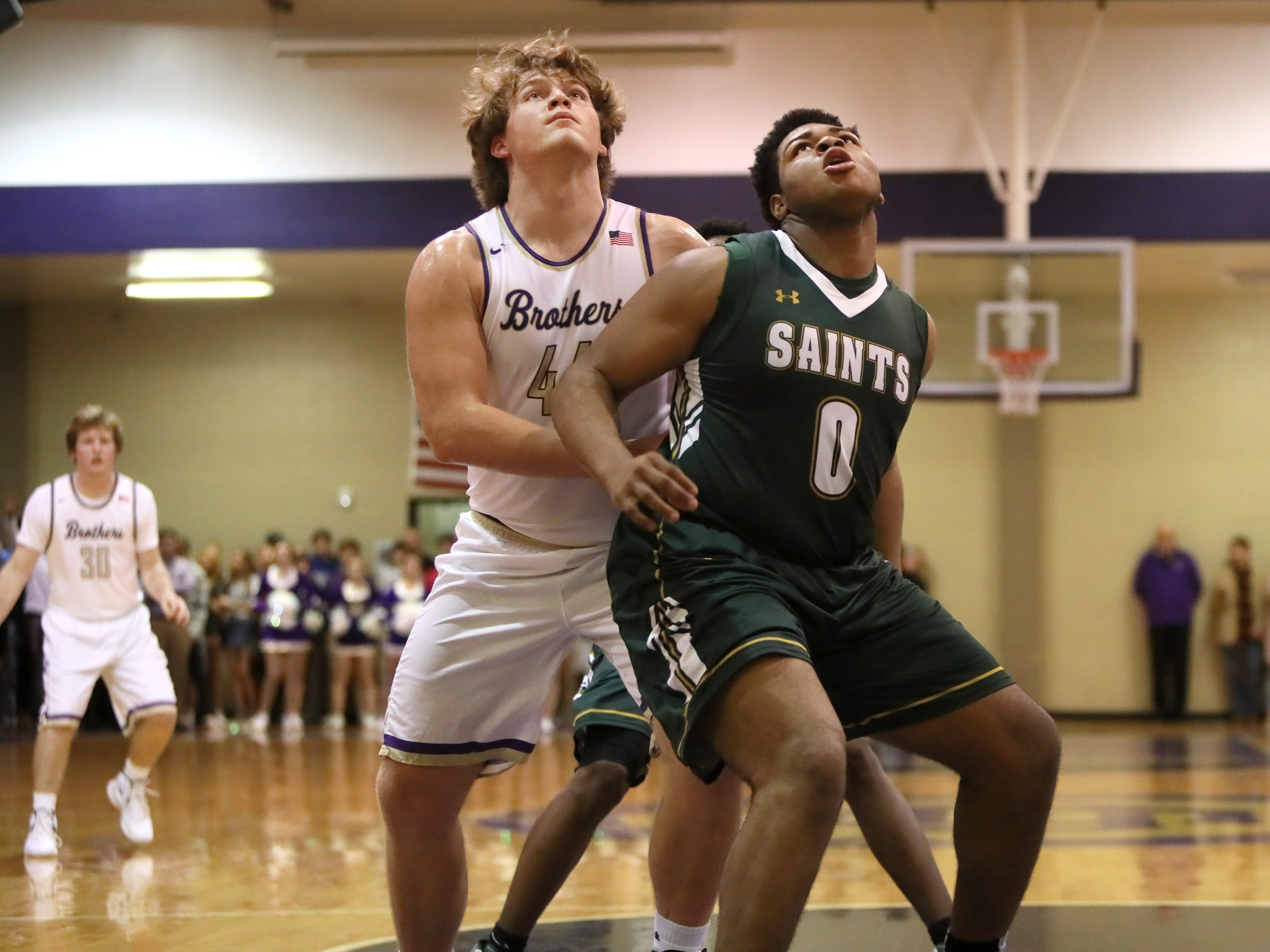 Briarcrest's Omari Thomas battles for position on a rebound with Christian Brothers' Bill Norton during their game at Christian Brothers High School on Friday, Jan. 11, 2019.