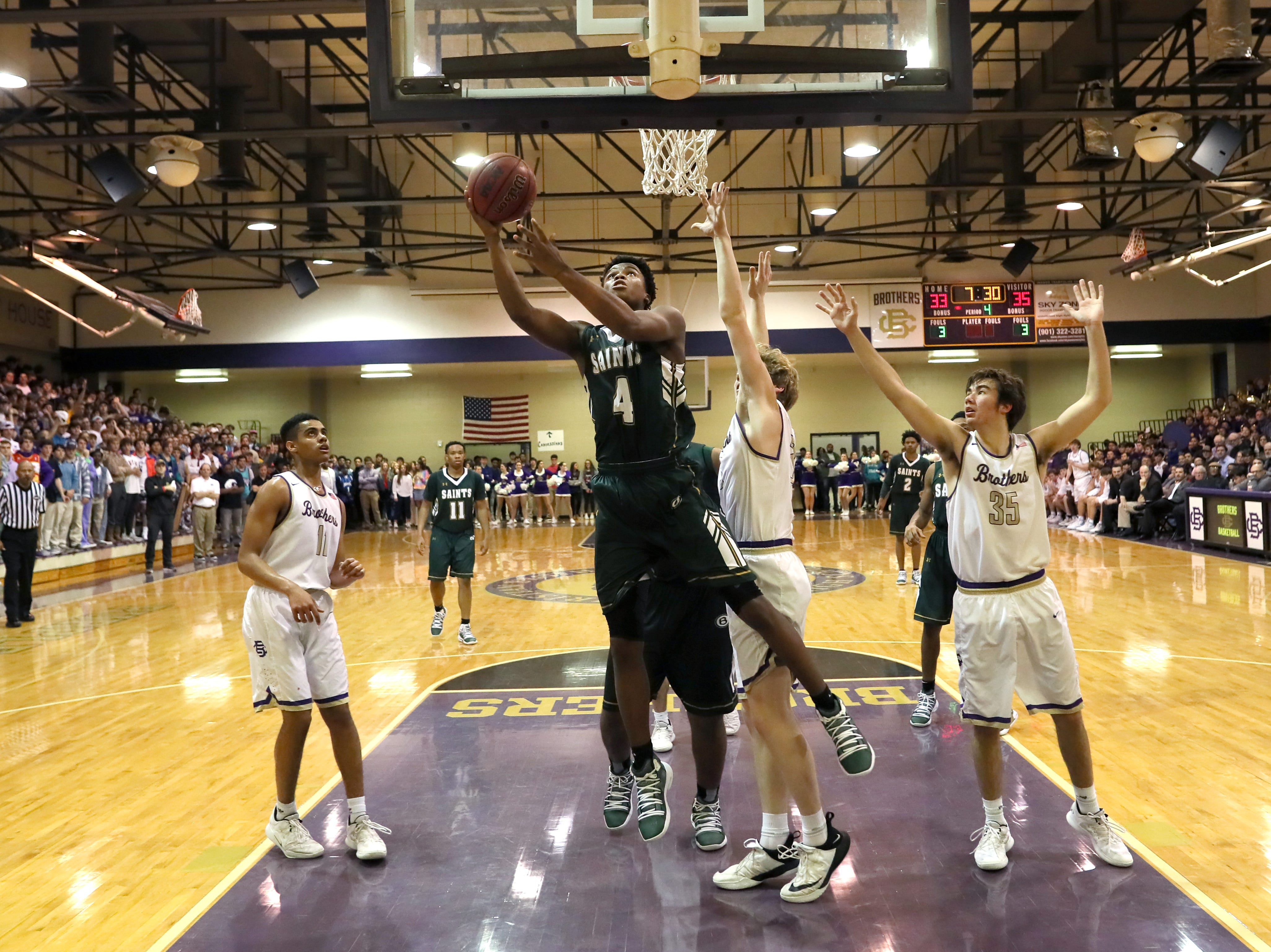 Briarcrest's Marcellus Brigham lays the ball up during their game at Christian Brothers High School on Friday, Jan. 11, 2019.