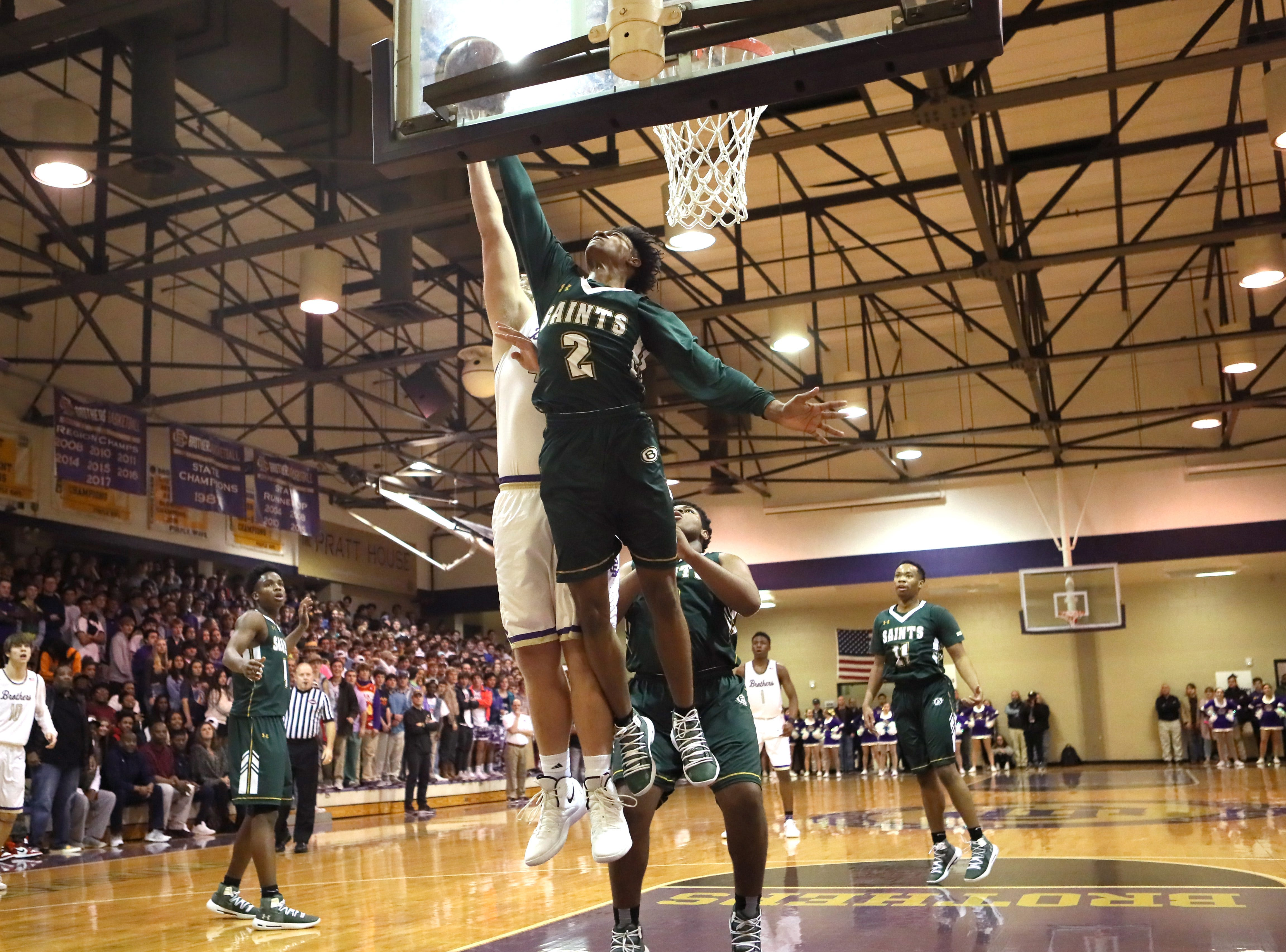 Briarcrest's Scooter Malone blocks a shot by Christian Brothers' Bill Norton during their game at Christian Brothers High School on Friday, Jan. 11, 2019.