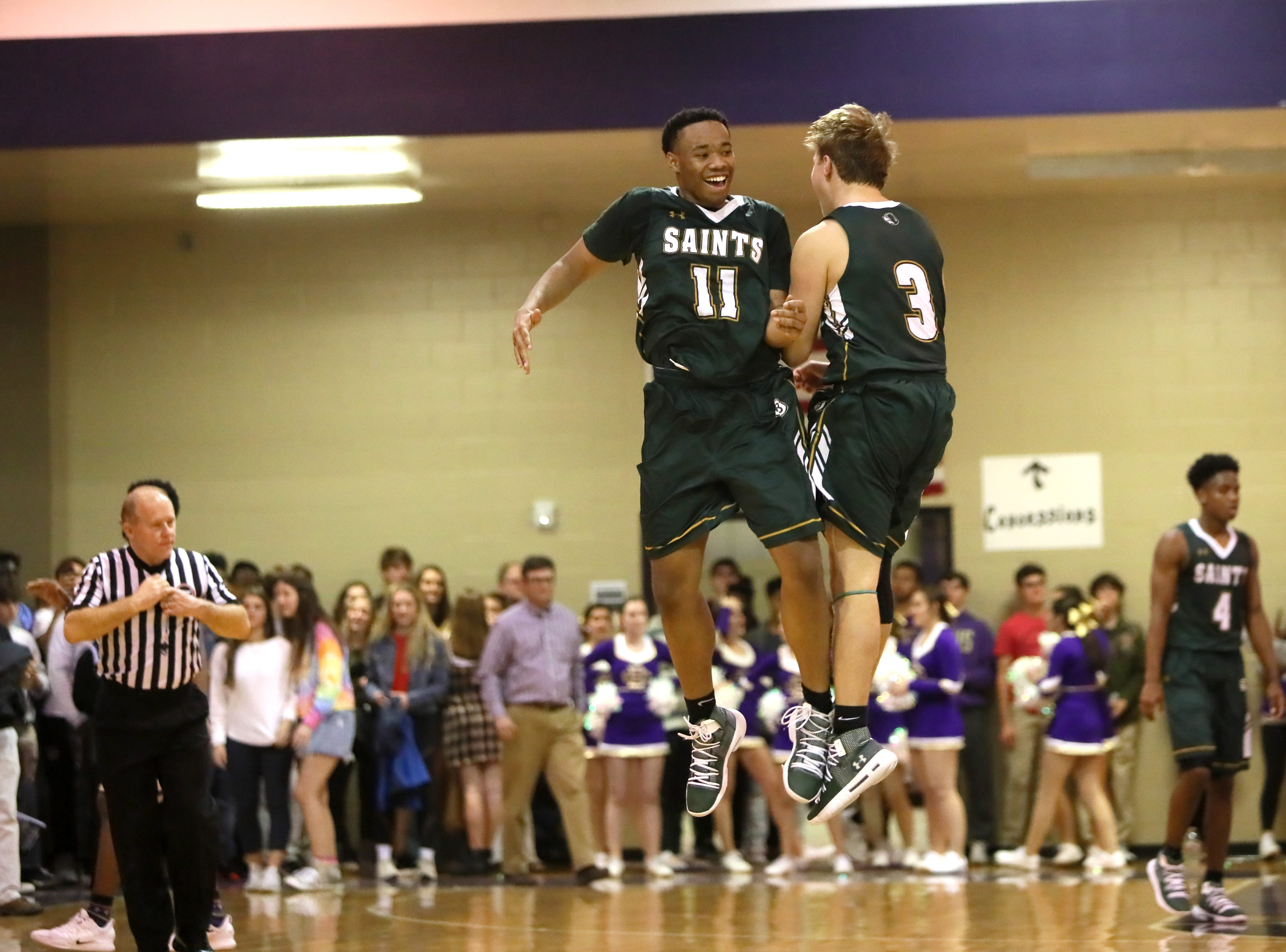 Briarcrest's Cleveland Yates, left, and Tyler Harrington celebrate their win at Christian Brothers High School on Friday, Jan. 11, 2019.