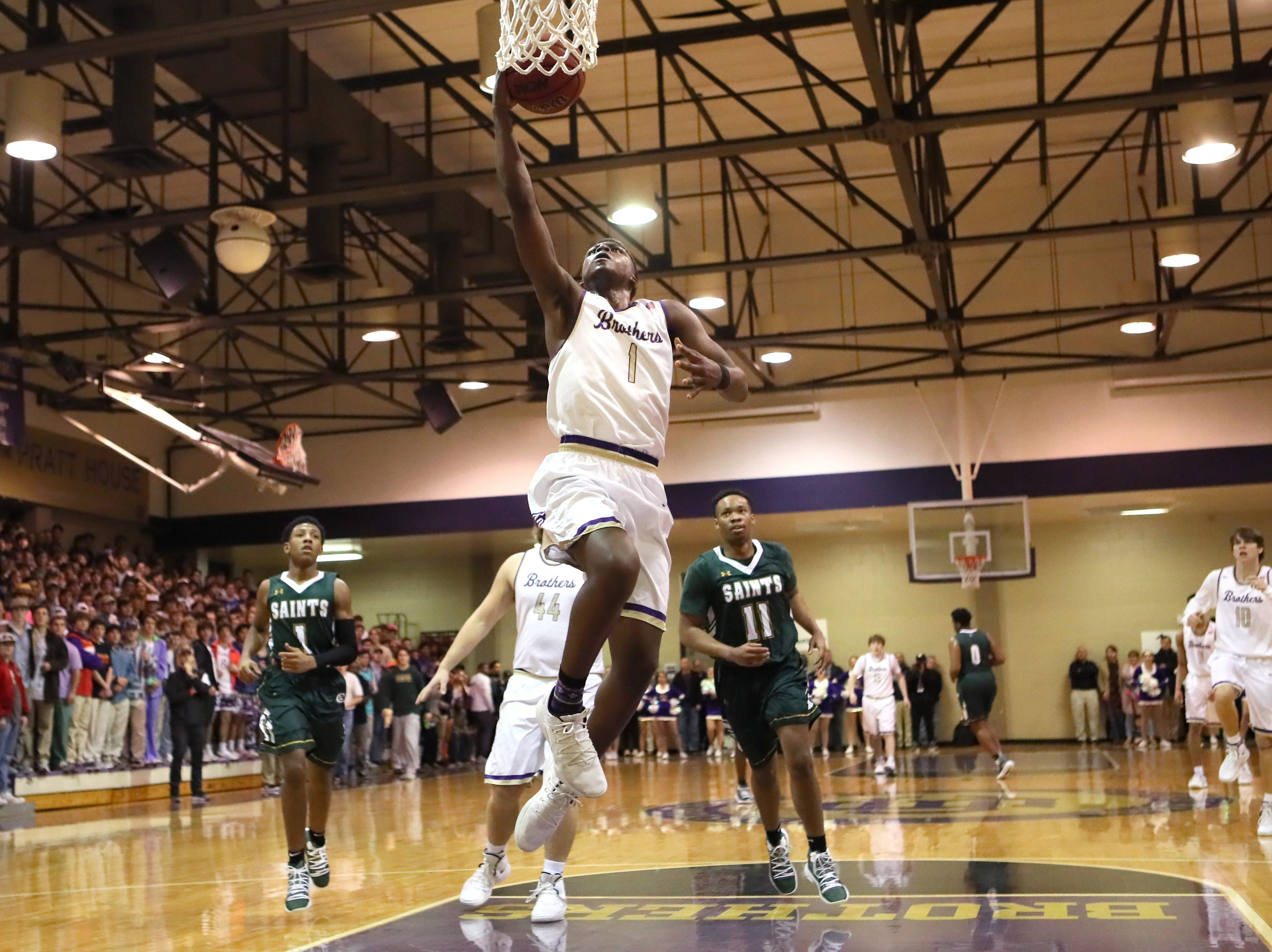 Christian Brothers' Chandler Jackson lays the ball up against Briarcrest during their game at Christian Brothers High School on Friday, Jan. 11, 2019.