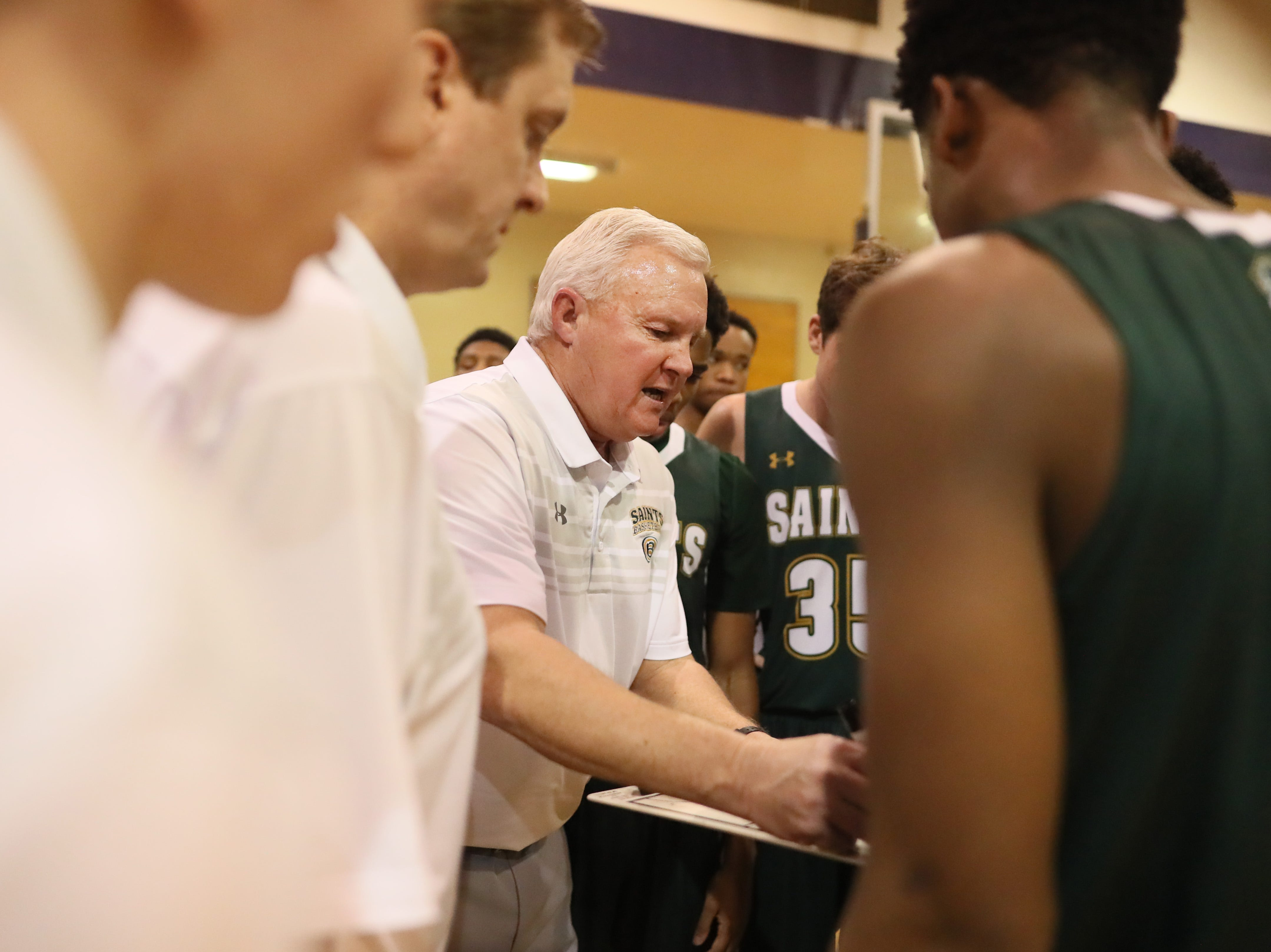 Briarcrest Head Coach John Harrington talks to his team during a timeout in their game at Christian Brothers High School on Friday, Jan. 11, 2019.