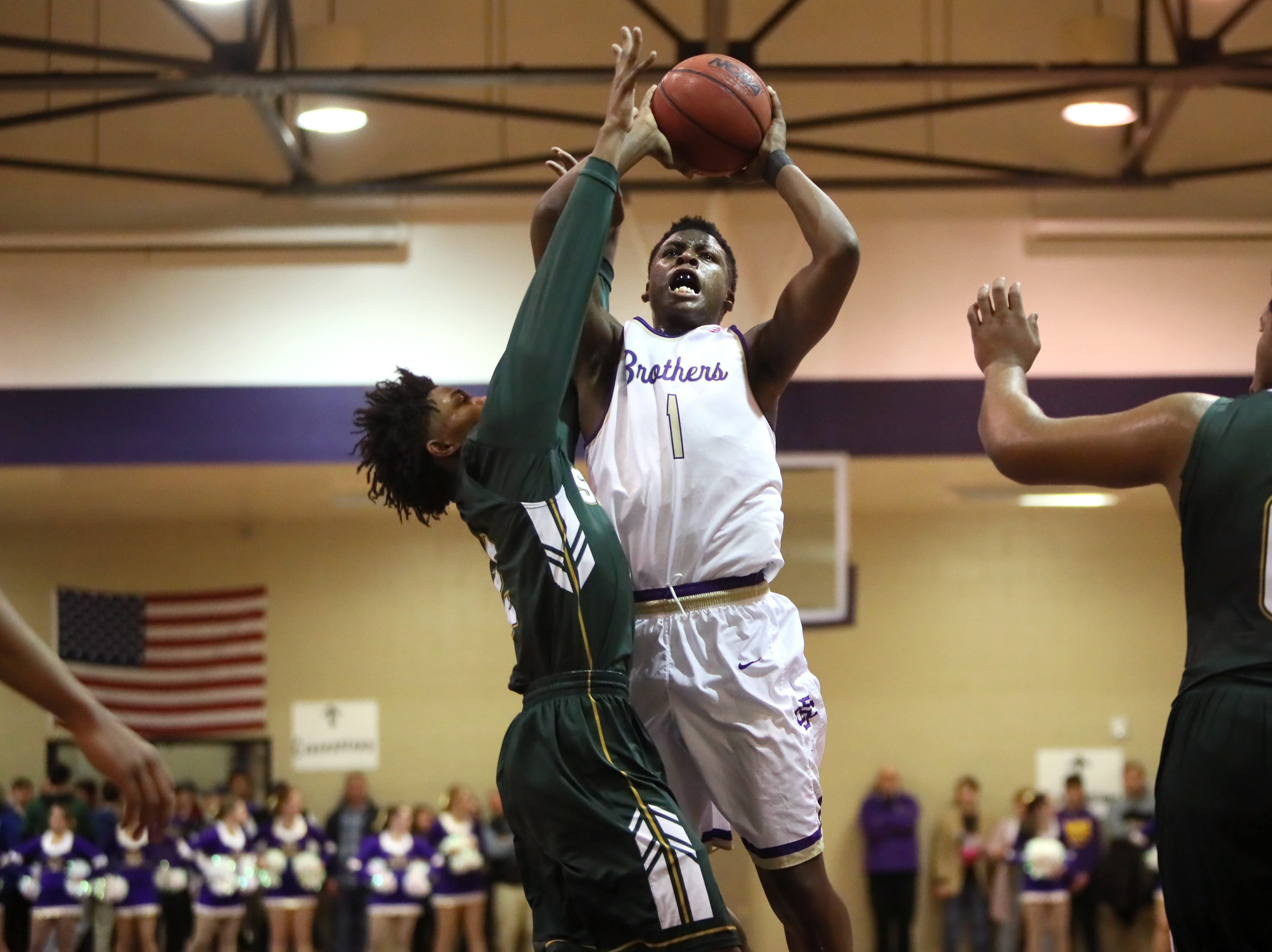 Christian Brothers' Chandler Jackson shoots the ball over Briarcrest's Scooter Malone during their game at Christian Brothers High School on Friday, Jan. 11, 2019.