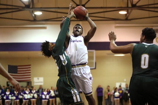 Christian Brothers' Chandler Jackson shoots over Briarcrest's Scooter Malone on Jan. 11, 2019. Jackson was first-team all-region as a freshman last season.