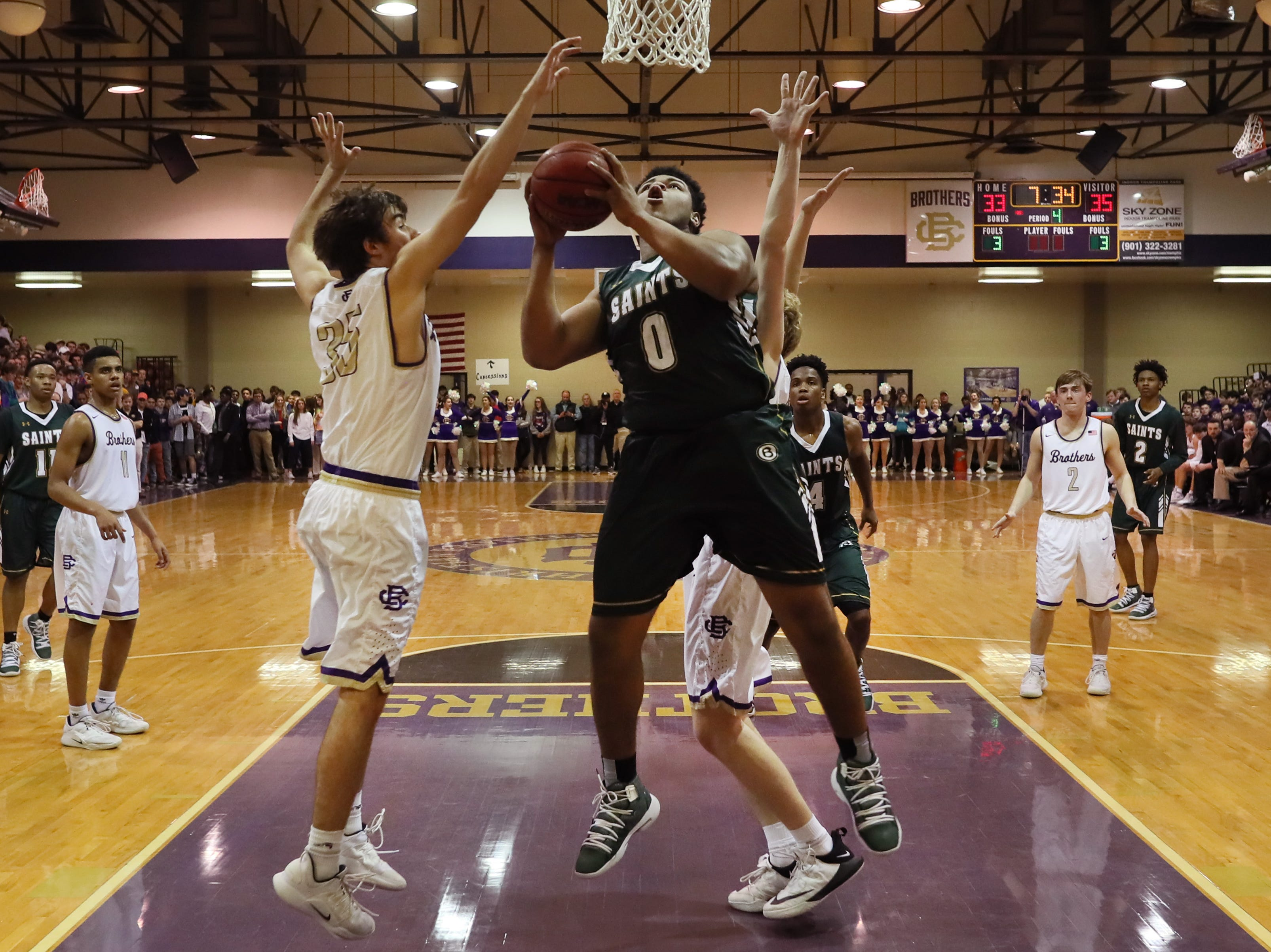 Briarcrest's Omari Thomas shoots the ball over Christian Brothers' Sam Spence during their game at Christian Brothers High School on Friday, Jan. 11, 2019.