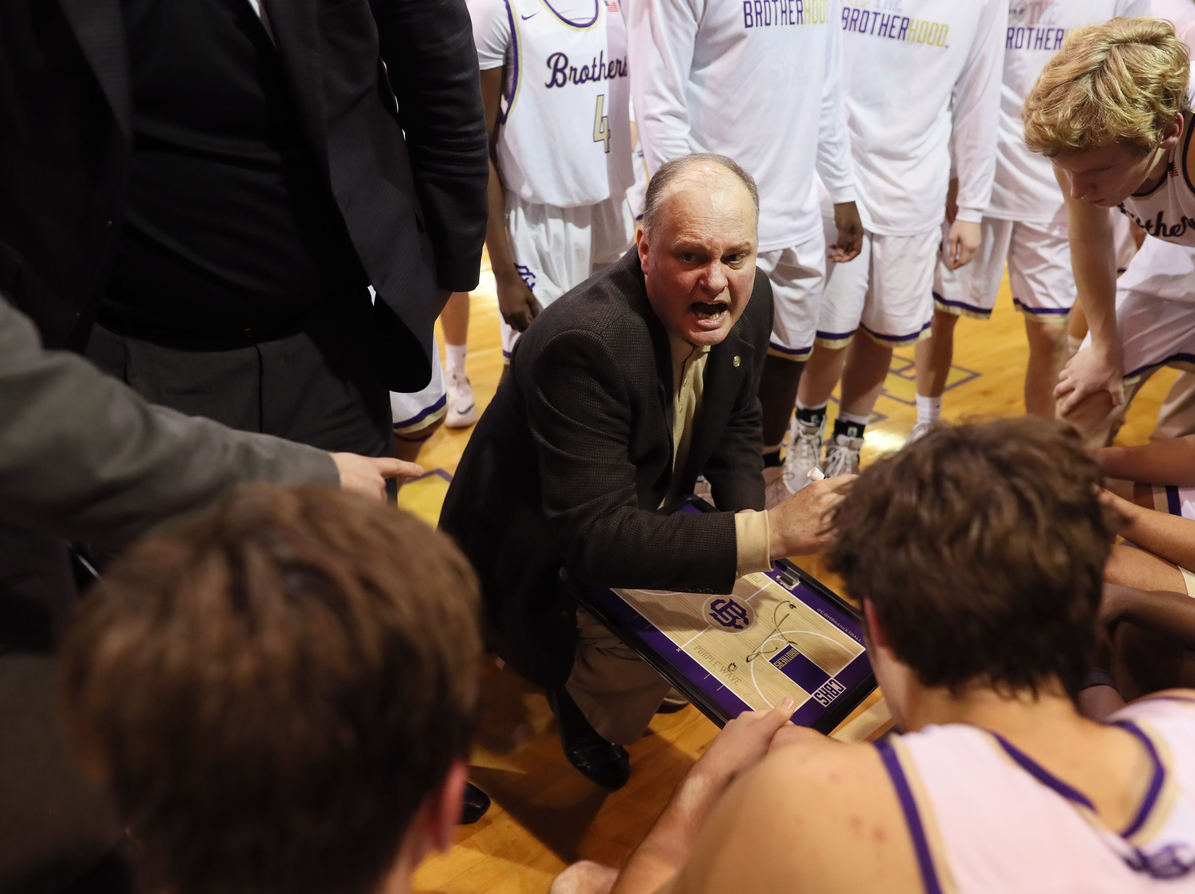 Christian Brothers Head Coach William Luckett talks to his team during a timeout in their game against Briarcrest at Christian Brothers High School on Friday, Jan. 11, 2019.
