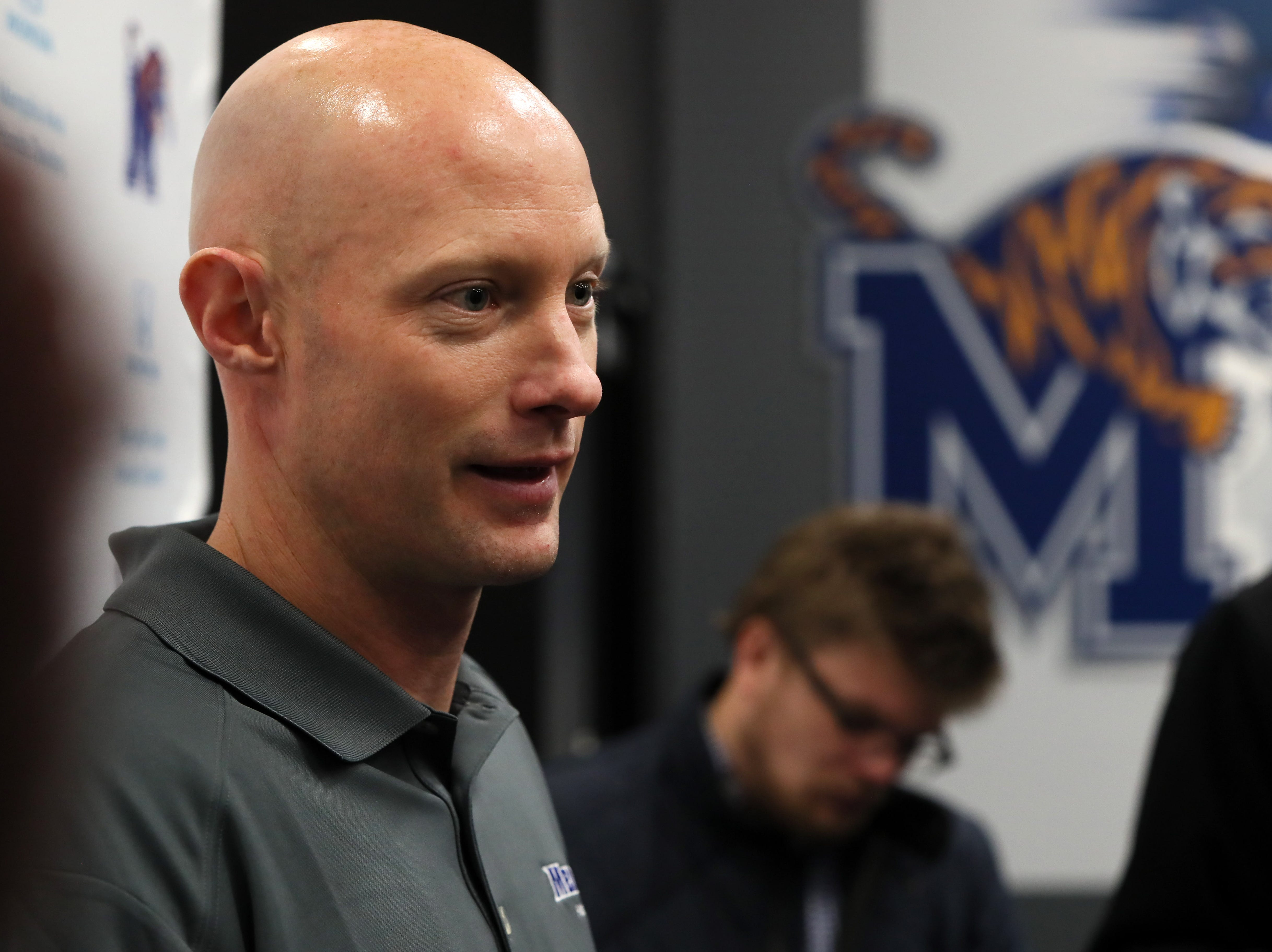Memphis Tigers Offensive Coordinator Kevin Johns talks to reporters during a press conference to introduce new coaching staff members on the university's campus Saturday, Jan. 12, 2019.