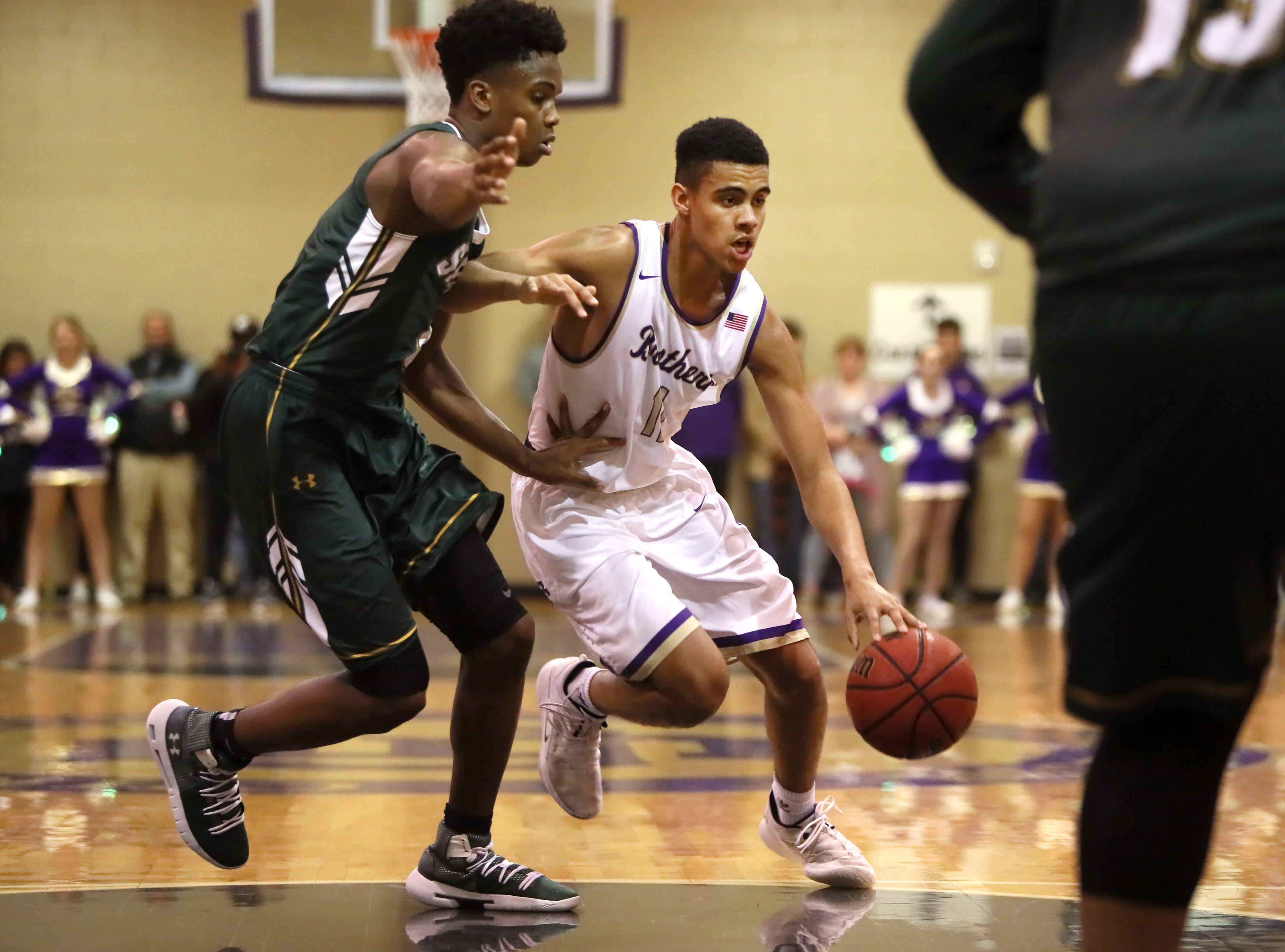 Christian Brothers' Reese Mcmullen drives past Briarcrest's Marcellus Brigham during their game at Christian Brothers High School on Friday, Jan. 11, 2019.