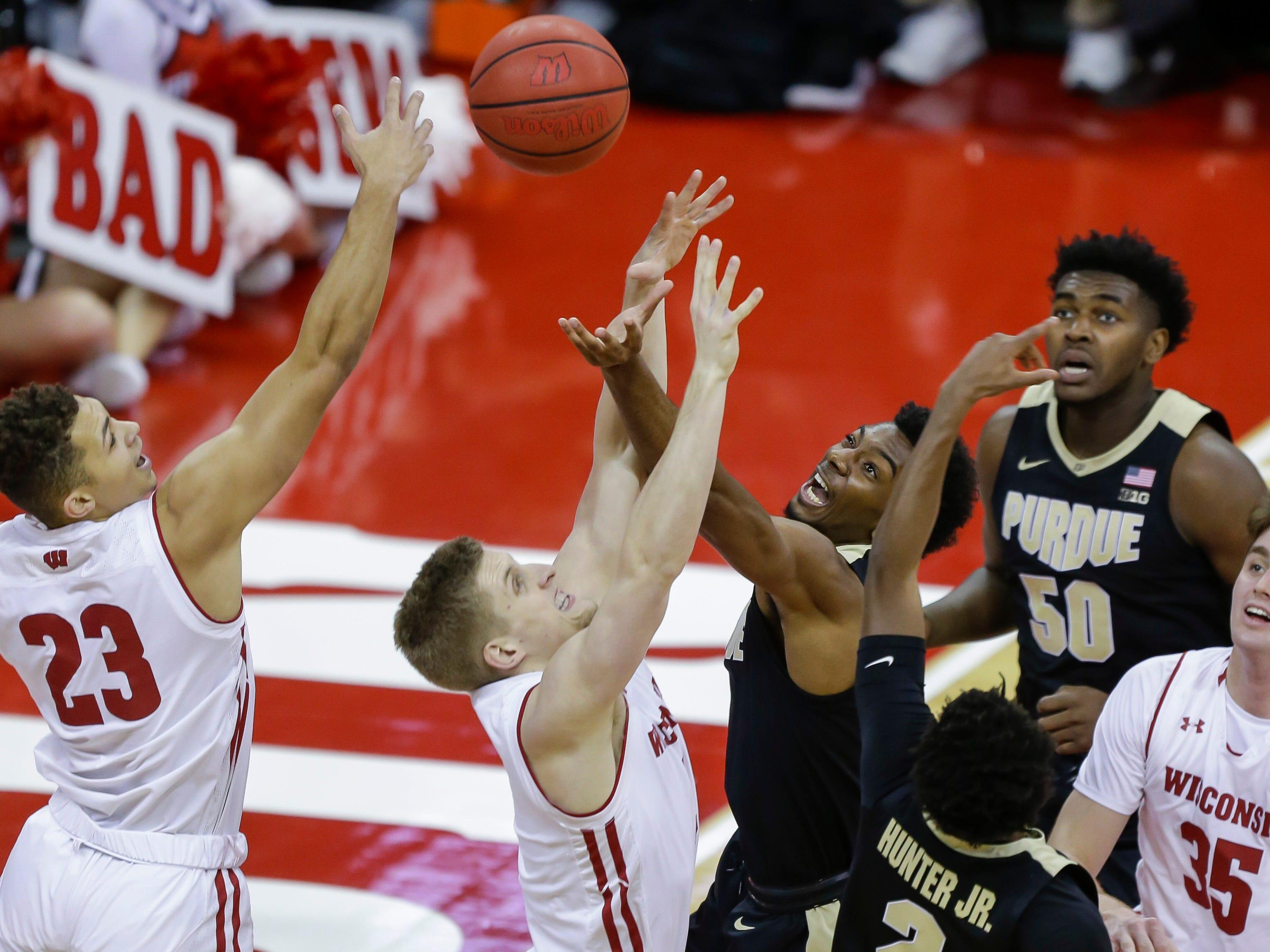 Wisconsin's Kobe King (from left), Brevin Pritzl, second from left, and Nate Reuvers compete against Purdue's Aaron Wheeler (center) and Eric Hunter for a rebound on Friday night.