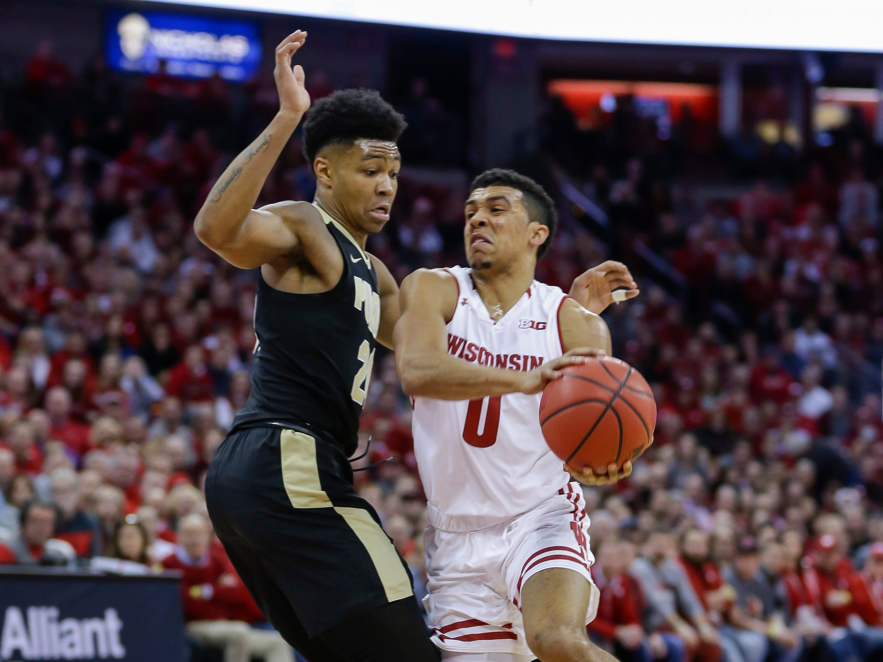 Wisconsin's D'Mitrik Trice drives on Purdue's Nojel Eastern during the second half Friday.
