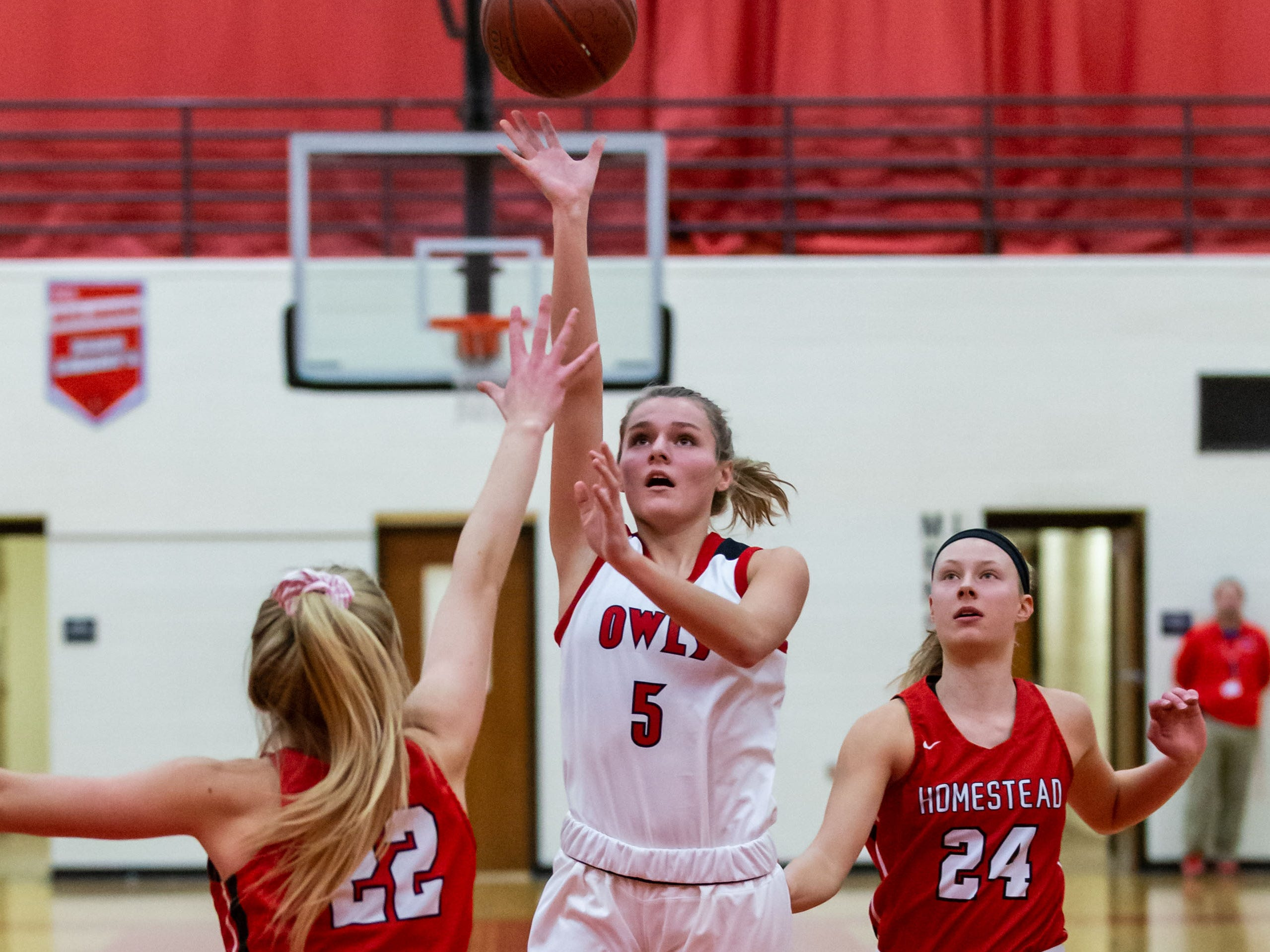 Slinger's Sydney Reinhardt (5) drives in for a shot during the game at home against Homestead on Friday, Jan. 11, 2019.