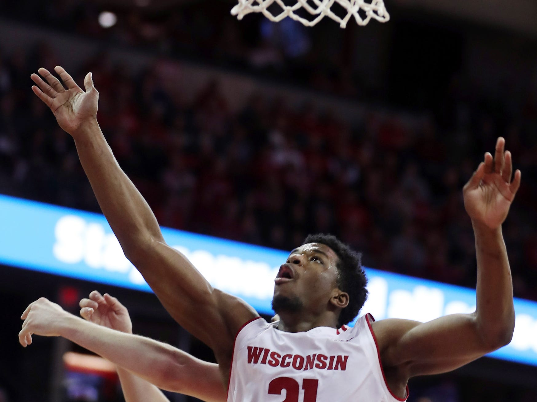 Badgers guard Khalil Iverson goes after a rebound against Purdue on Friday night.