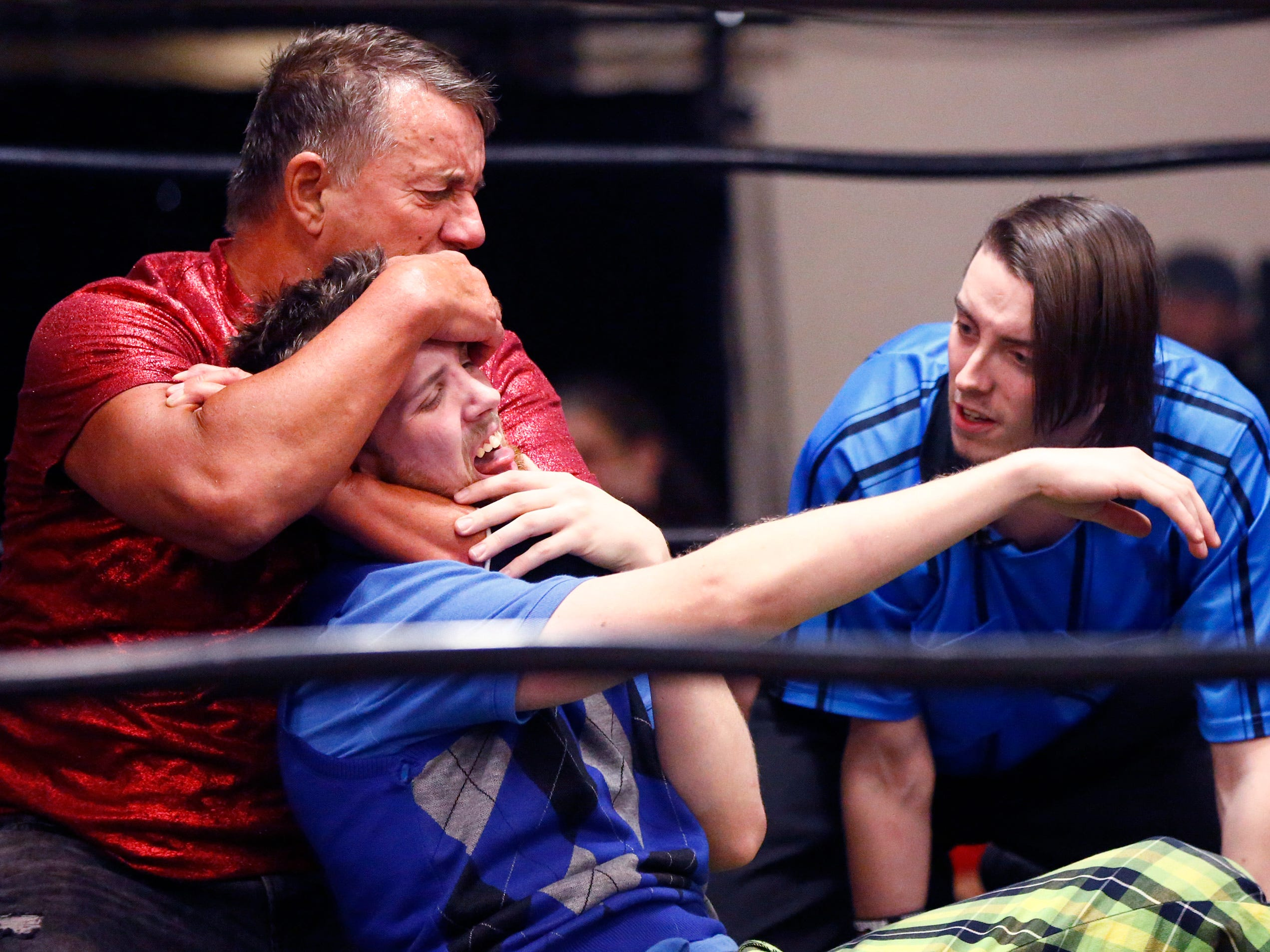 """Angel Armani puts Lou Zhur into a headlock during the Brew City Wrestling """"Rise To Honor XV- 15 Years of FAN-demonium"""" event at the Waukesha Elks Lodge on Jan. 11 that featured seven matches during the evening."""