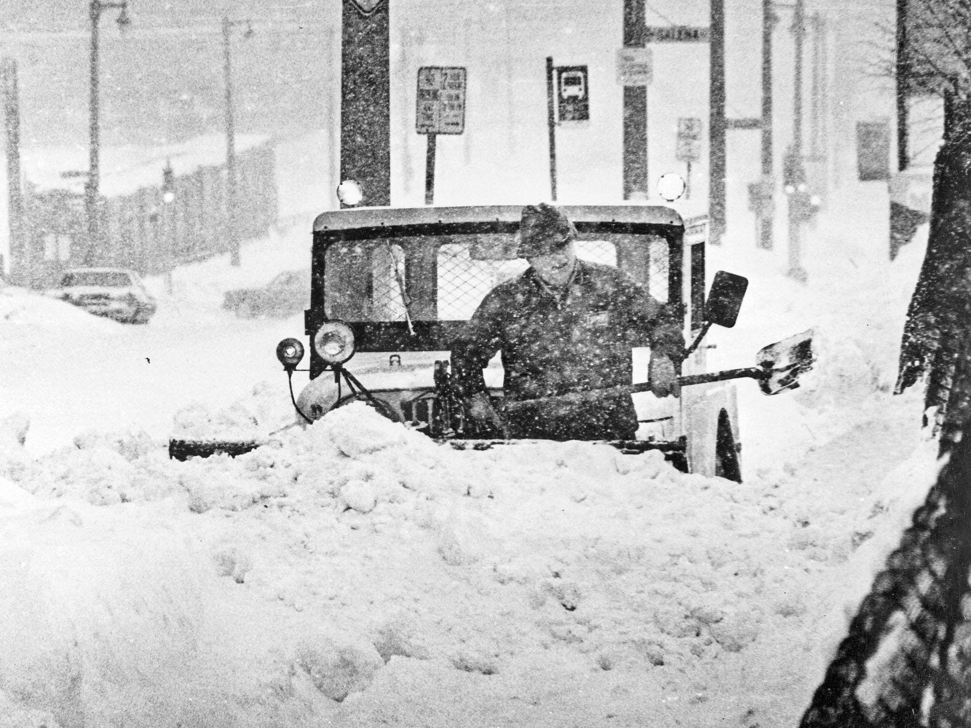 A sidewalk snow-plower, stuck on what then was North Third Street north of West Galena Street, has to take matters into his own hands to dig out during a blizzard in Milwaukee on Jan. 24, 1979. This photo was published in the Jan. 25, 1979, Milwaukee Journal.