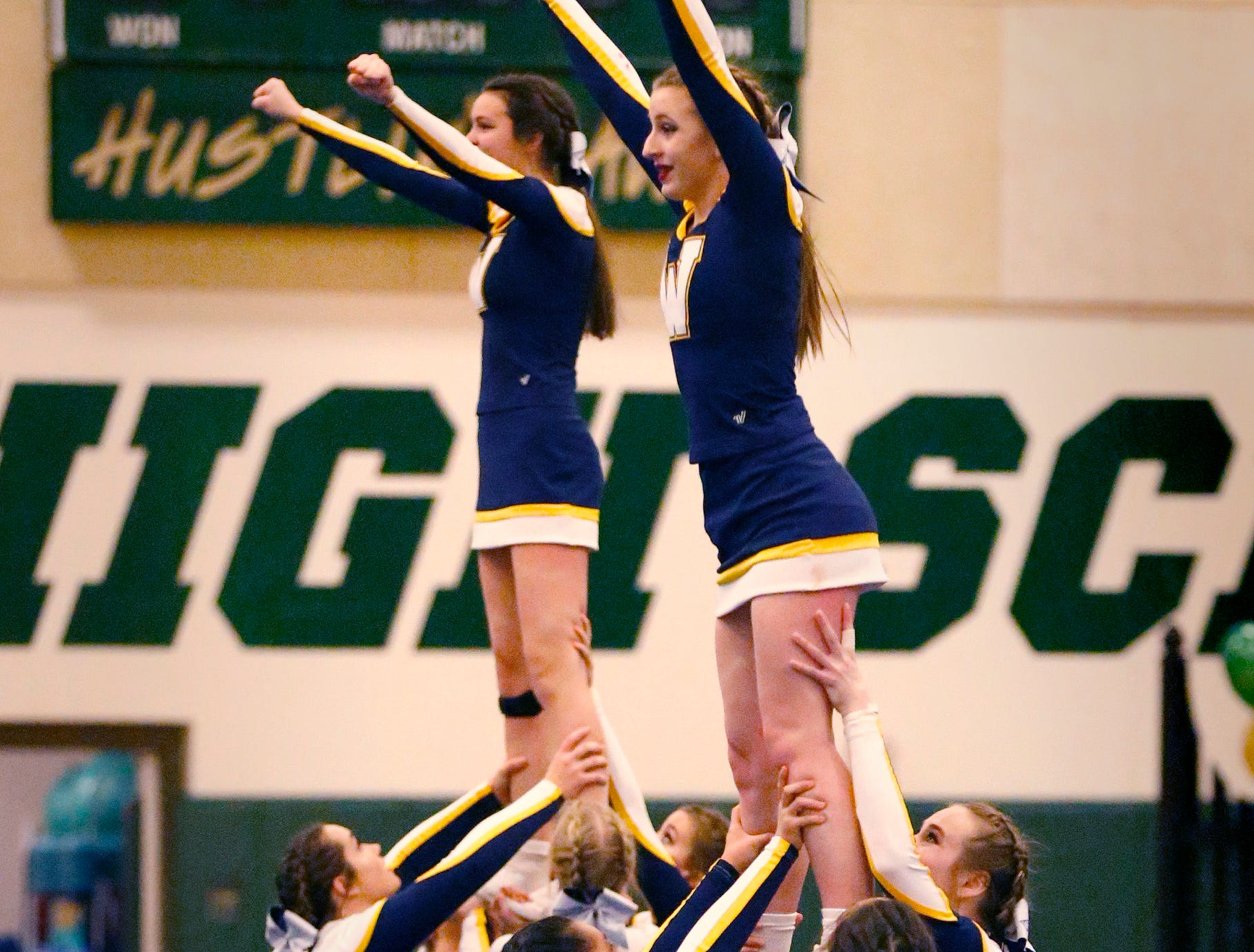 The Whitnall High School team finishes a stack in the varsity non-tumble division during the Greenfield Xtreme Cheer competition at Greenfield High School on Jan. 12 that drew 56 teams competing in 13 divisions.