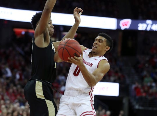 Purdue's Nojel Eastern plays suffocating defense on Badgers guard D'Mitrik Trice on Friday night.
