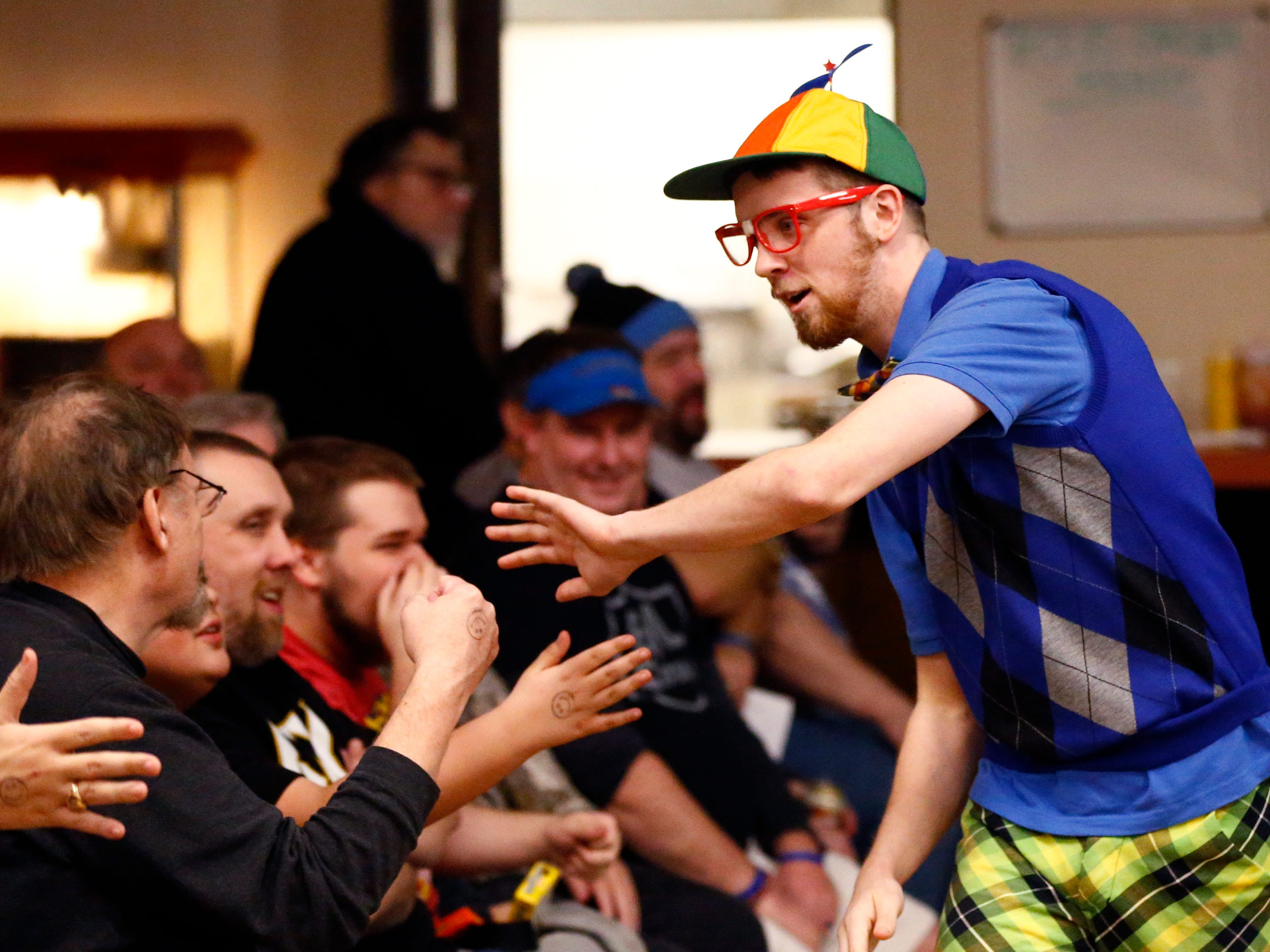 """Lou Zhur greets the crowd before the start of his match with Angel Armani during the Brew City Wrestling """"Rise To Honor XV- 15 Years of FAN-demonium"""" event at the Waukesha Elks Lodge on Jan. 11 that featured seven matches during the evening."""
