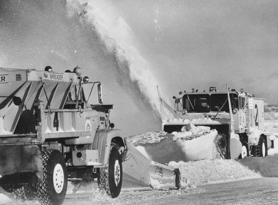 Trucks struggle to move the tons of snow piled on runways at Mitchell International Airport on Jan. 14, 1979. The blizzard that socked Milwaukee resulted in scores of flight cancellations. This photo was published in the Jan. 15, 1979, Milwaukee Sentinel.