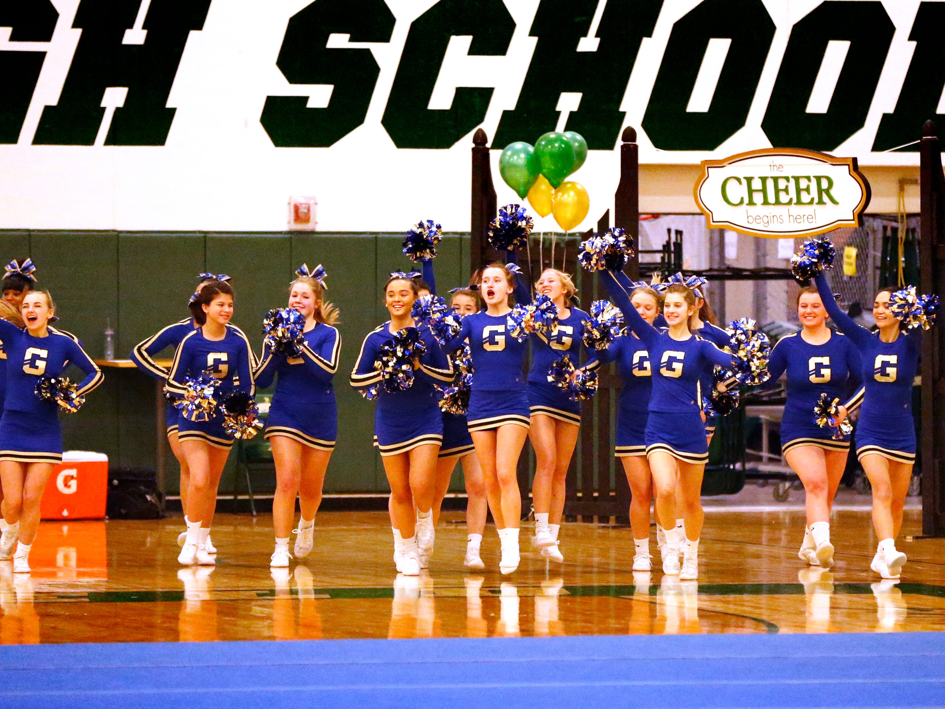 The Germantown High School team takes the floor to compete in the cheer dance division during the Greenfield Xtreme Cheer competition at Greenfield High School on Jan. 12 that drew 56 teams competing in 13 divisions.