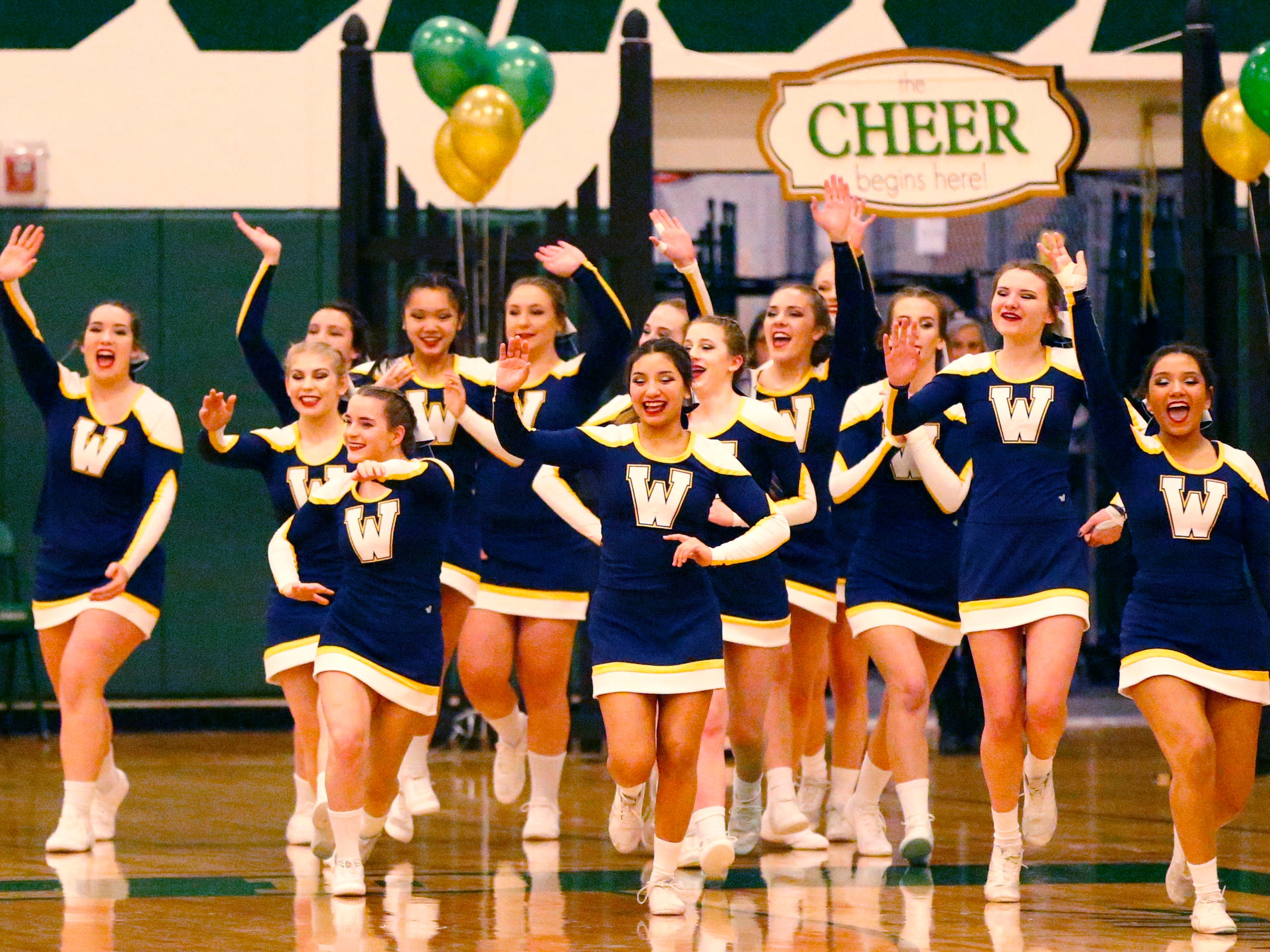 The Whitnall High School team takes the floor to compete in the varsity non-tumble division during the Greenfield Xtreme Cheer competition at Greenfield High School on Jan. 12 that drew 56 teams competing in 13 divisions.