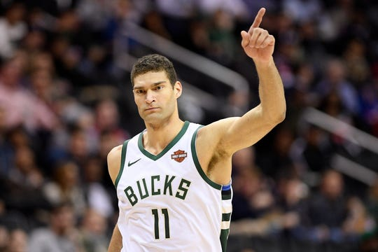 Bucks center Brook Lopez gestures after canning a three-pointer against the Wizards on Friday night.