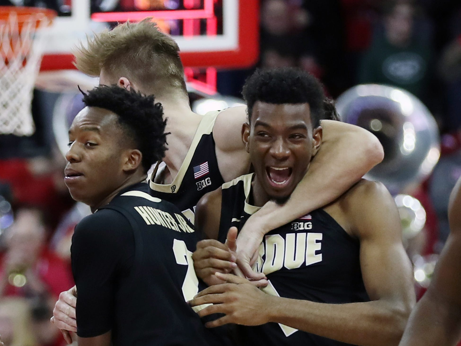 Purdue Boilermakers players celebrate after beating the Wisconsin Badgers in overtime on Friday night at the Kohl Center.