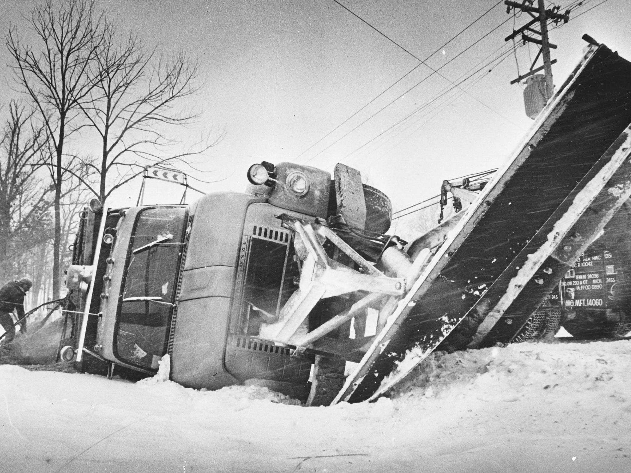 A City of Milwaukee snowplow careens into the ditch after being forced onto the shoulder of the 3400 block of W. College Ave. during plowing on Jan. 13, 1979. The plow and driver were both back on the road in a few hours, trying to deal with the city's second blizzard in two weeks. This photo was published in the Jan. 14, 1979, Milwaukee Journal.