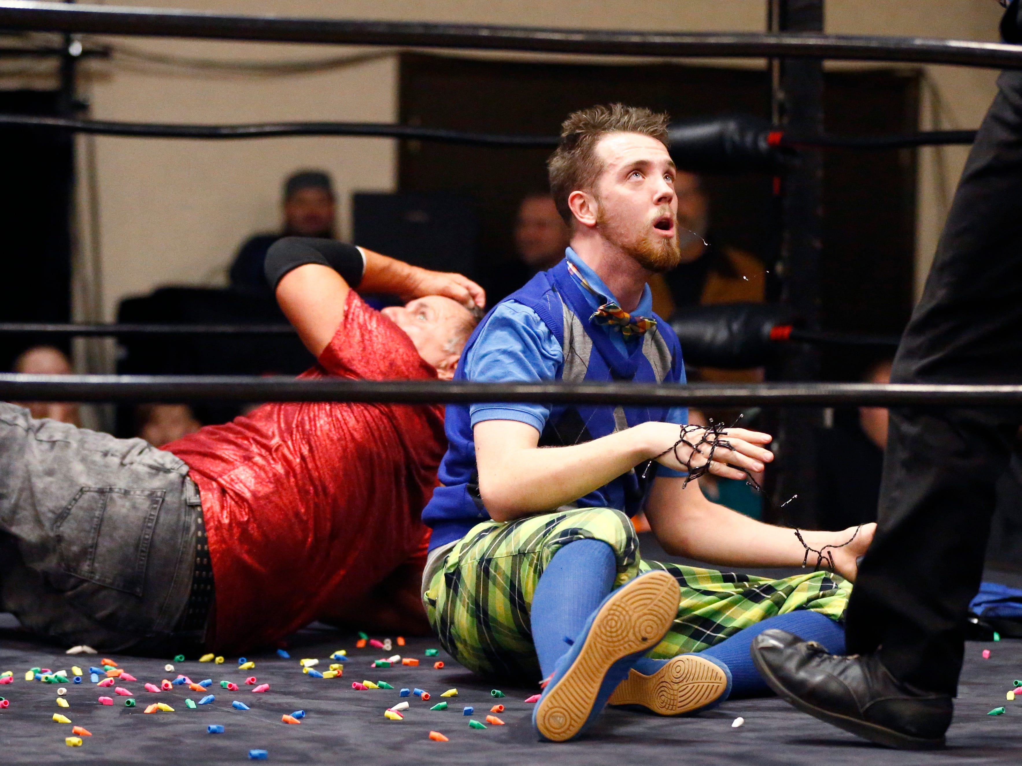 """Lou Zhur listens to the referee's call while battling Angel Armani during the Brew City Wrestling """"Rise To Honor XV- 15 Years of FAN-demonium"""" event at the Waukesha Elks Lodge on Jan. 11 that featured seven matches during the evening."""