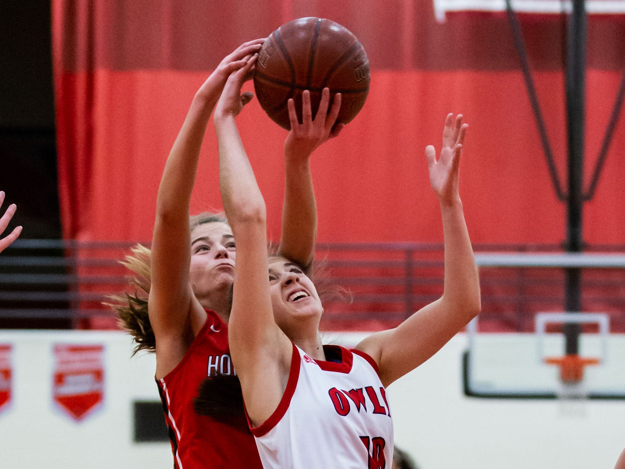 Homestead's Chloe Sileno (left) battles for a rebound with Slinger's Maddie Rothenhoefer during the game at Slinger on Friday, Jan. 11, 2019.