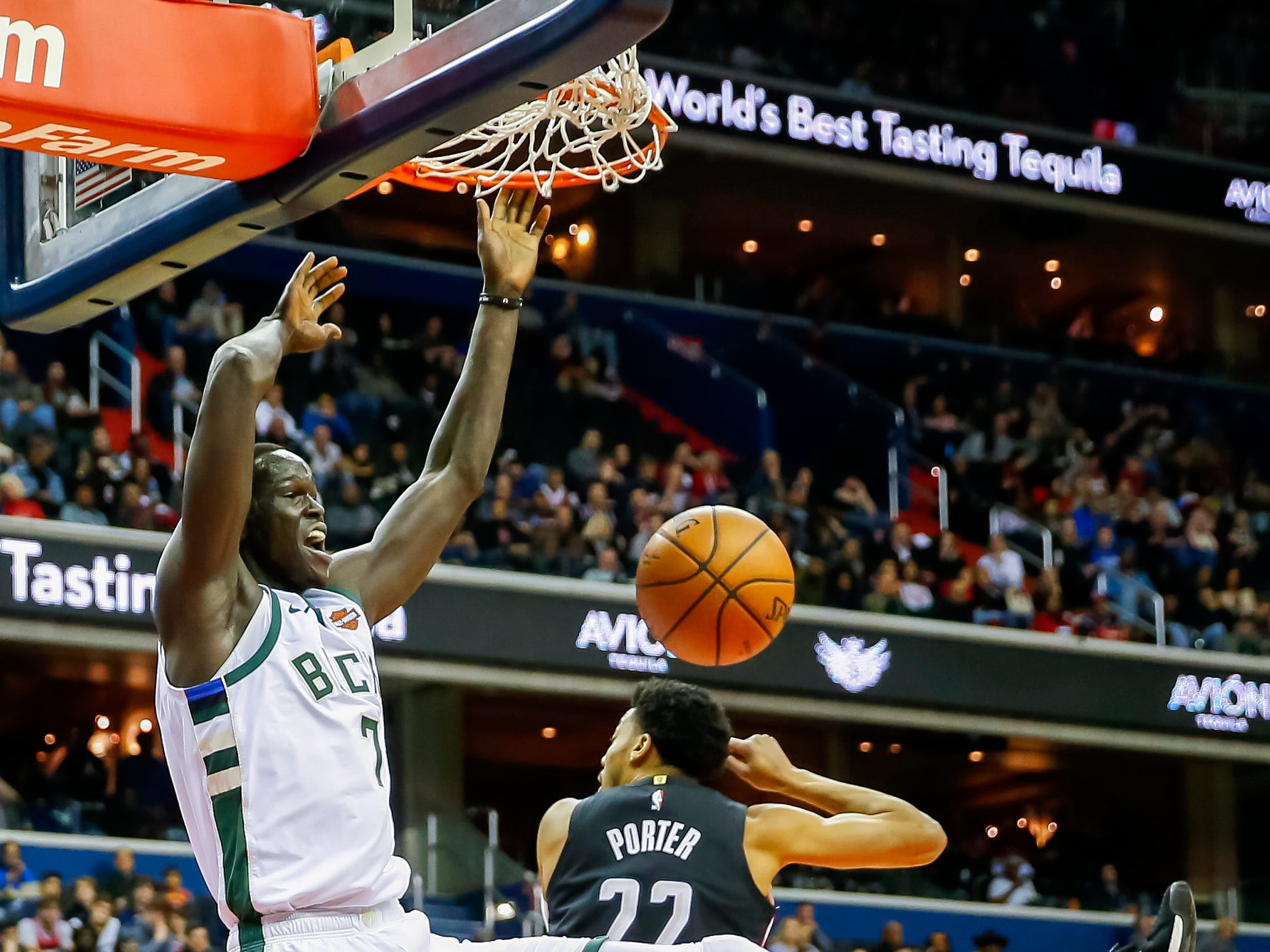 Bucks forward Thon Maker dunks over the Wizards' Otto Porter Jr. on Friday night.