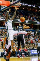 Bucks forward Thon Maker dunks over the Wizards' Otto Porter Jr. in a recent game.