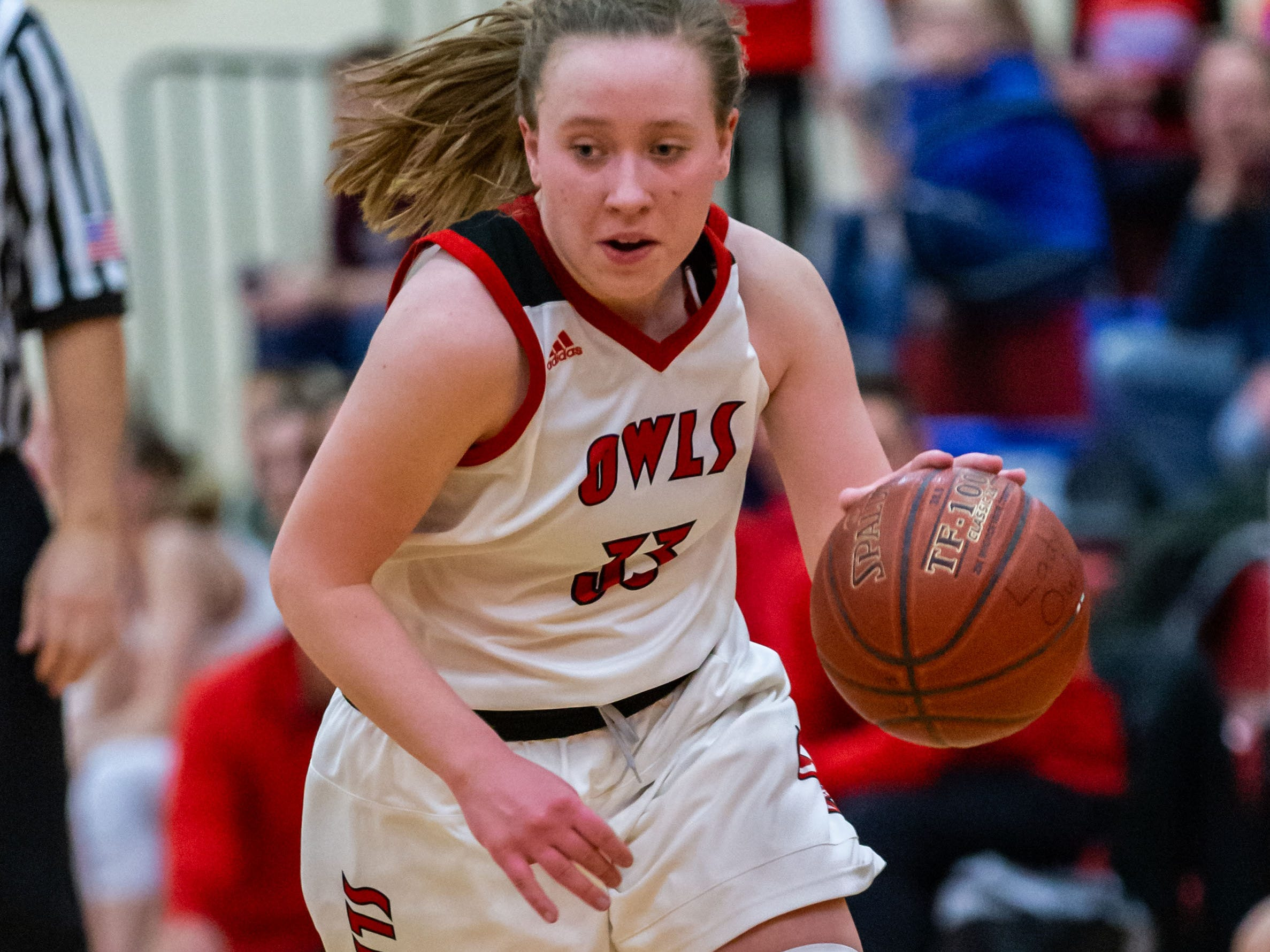 Slinger's Hannah Brooks (33) races downcourt during the game at home against Homestead on Friday, Jan. 11, 2019.