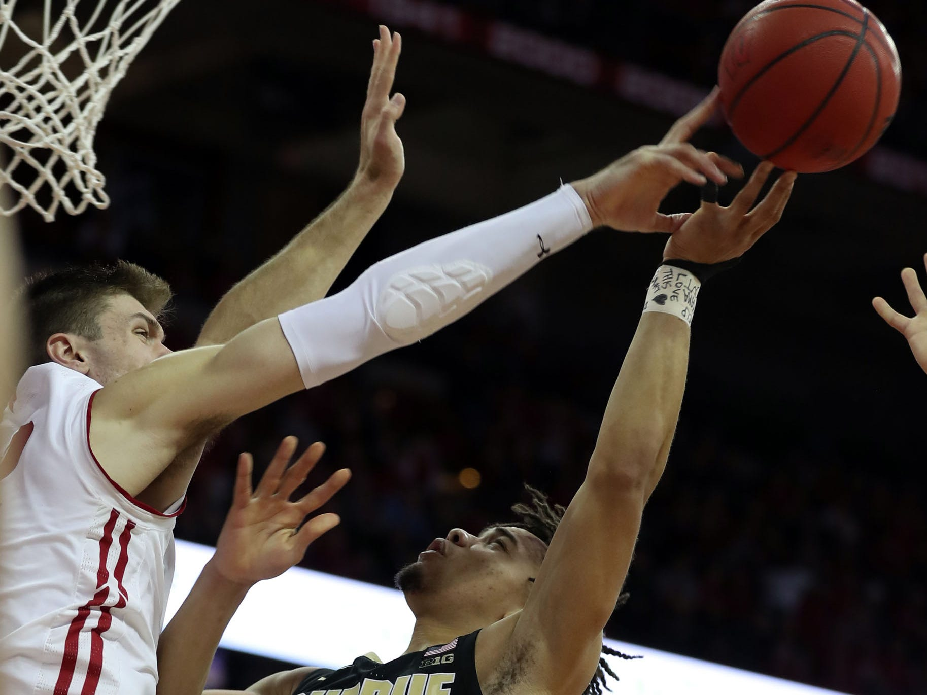 Wisconsin forward Ethan Happ blocks an attempted shot by Purdue guard Carsen Edwards during the first half Friday night.