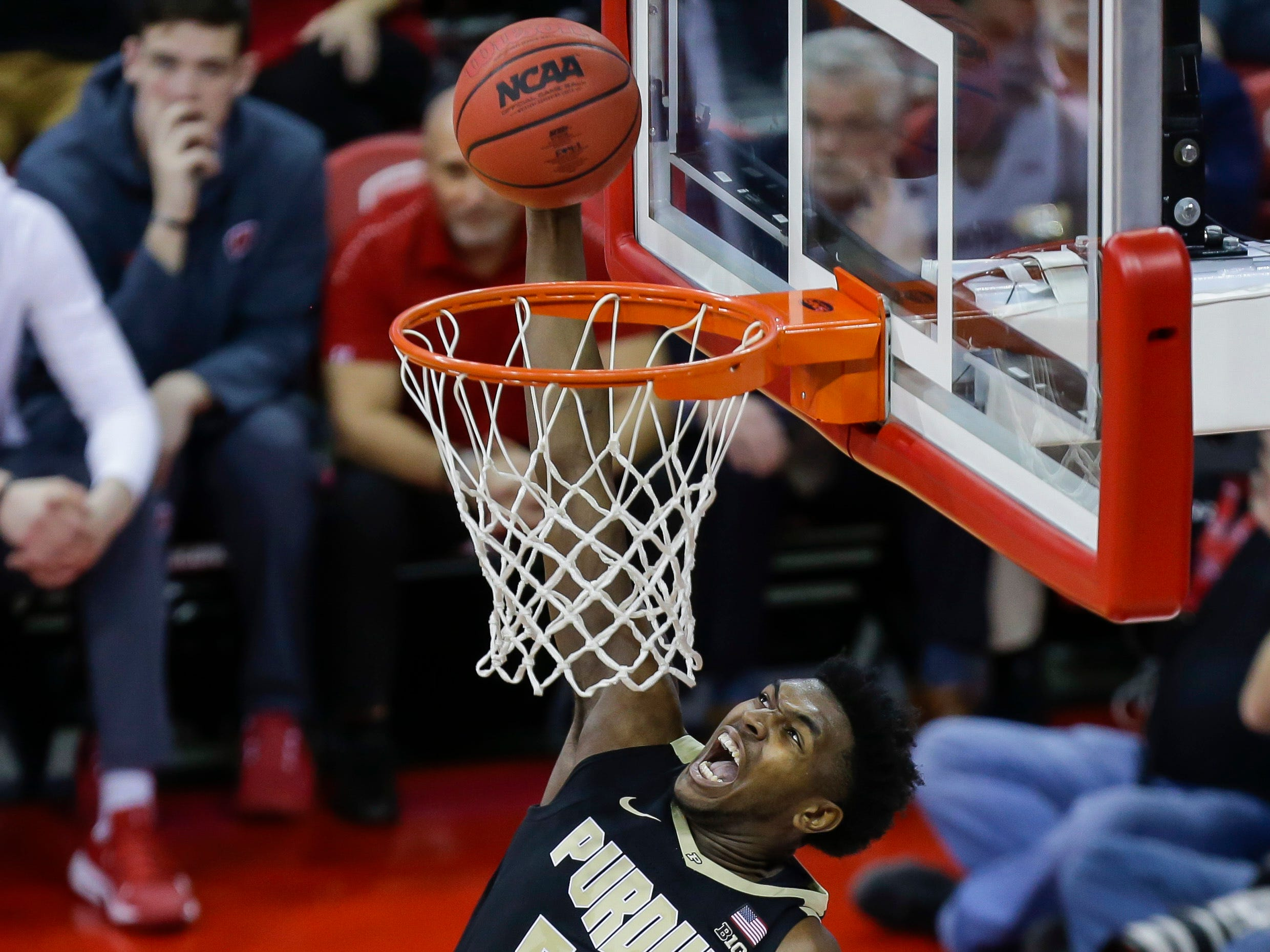 Purdue's Trevion Williams hammers down a dunk against Wisconsin's Nate Reuvers during the first half Friday.